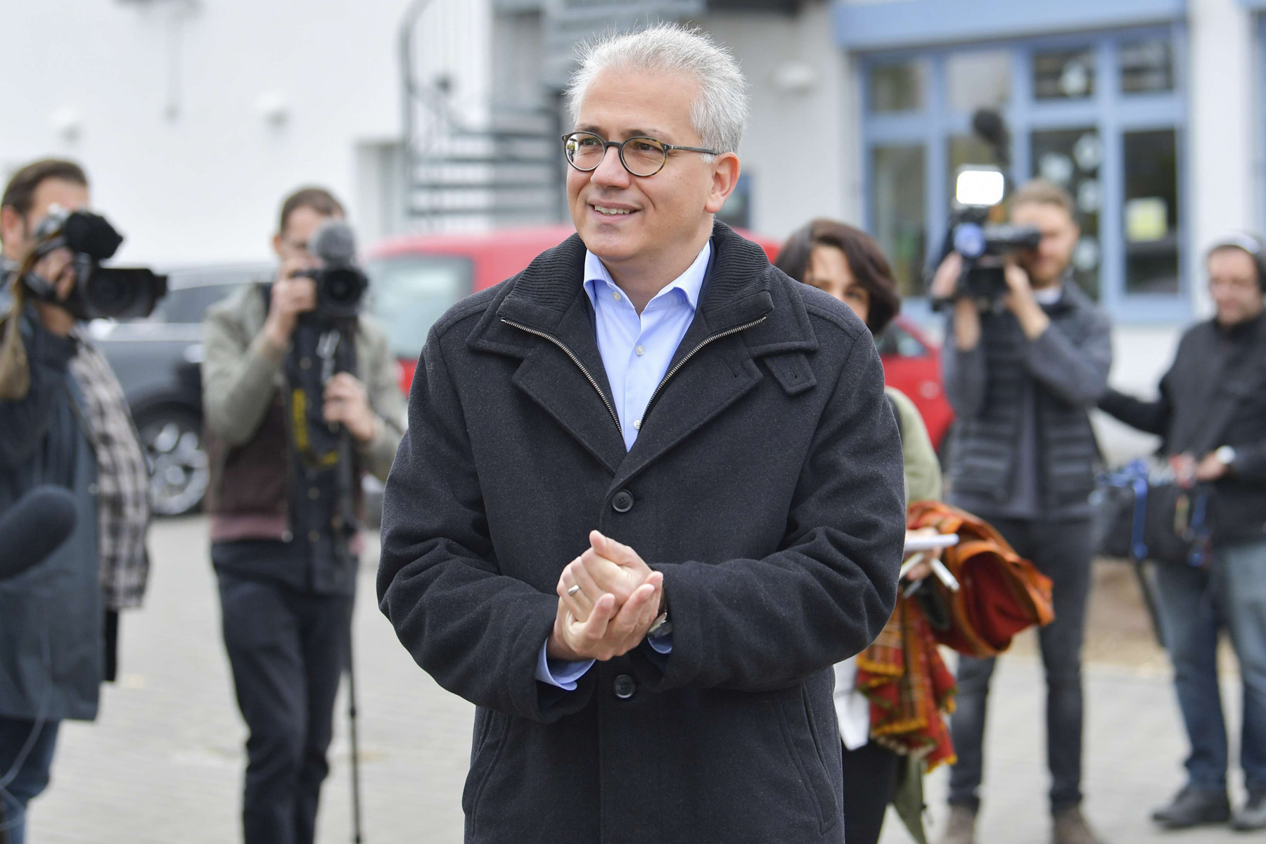 A man on a mission. Tarek al-Wazir leaves the polling station after he cast his vote for the Hesse state election in Offenbach, on October 28.          (AP)