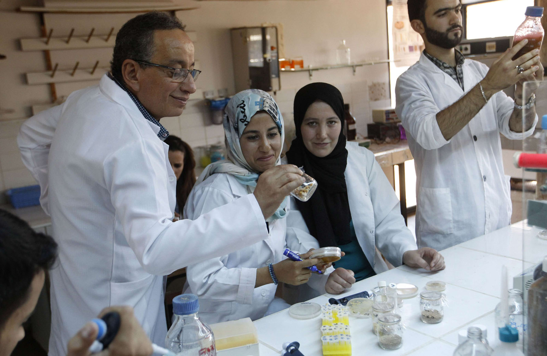 A focus on health and education. A Moroccan professor works with his team at the Sidi Mohamed Ben Abdellah University in Fez.     (AFP)