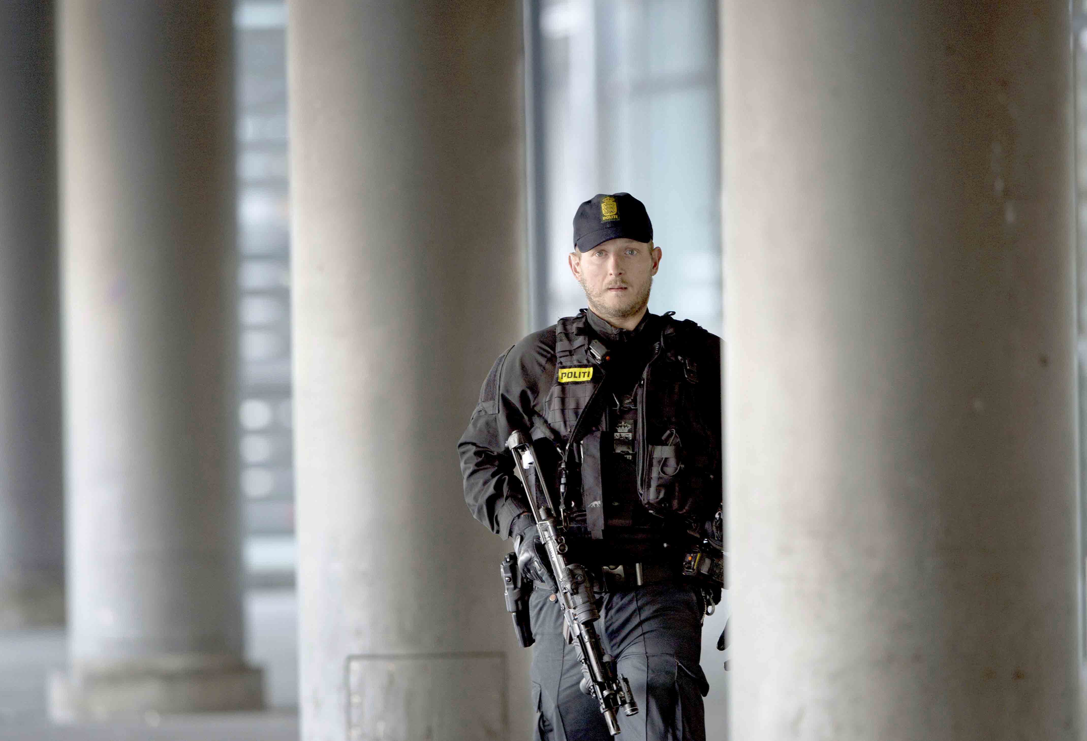 A Danish policeman stands guard outside a building in Copenhagen. (AFP)