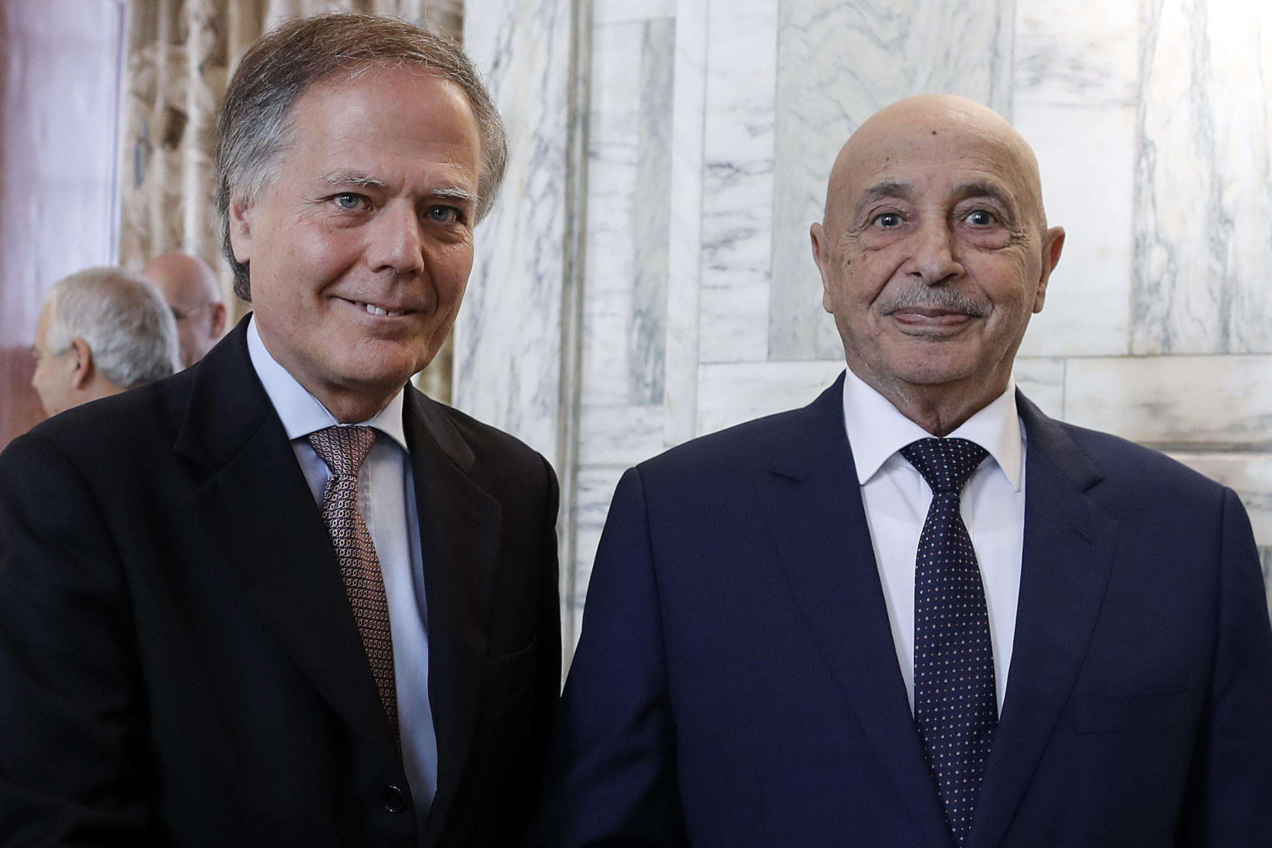 Italian Foreign Minister Enzo Moavero Milanesi (L) and President of the Libyan House of Representatives in Tobruk Ageela Saleh prior their meeting in Rome, on October 31. (AP)