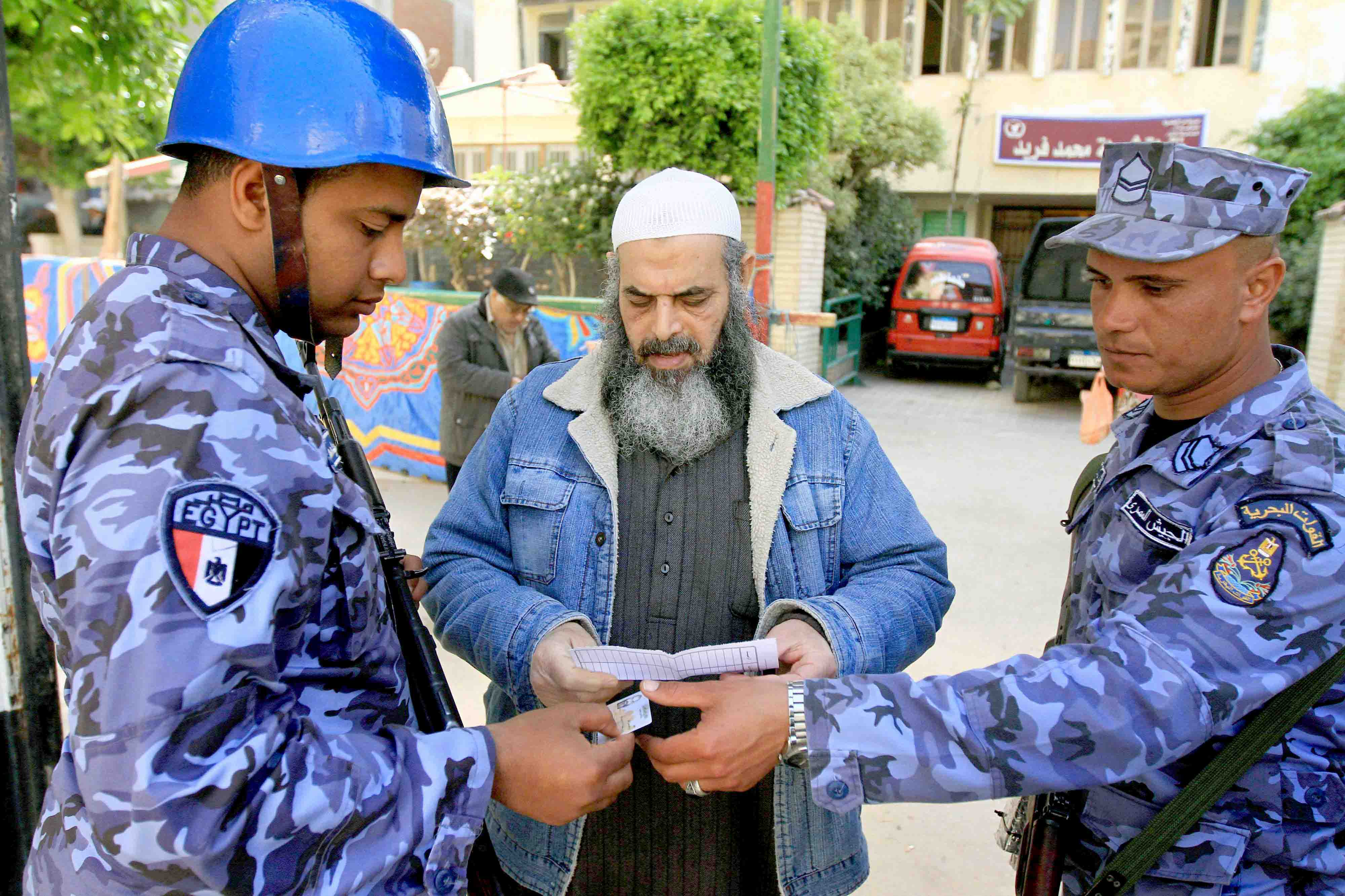 In check. Egyptian naval conscripts check the ID of a Salafist man in al-Montazah district of Egypt's second city of Alexandria, last March. (AFP)
