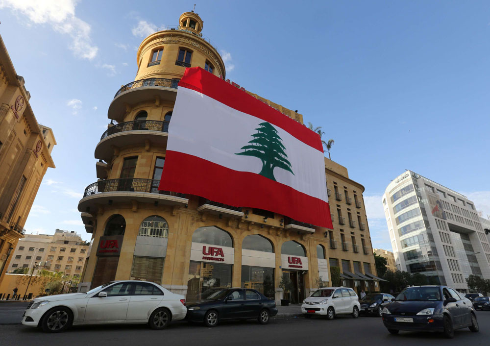 Hope and challenges. A Lebanese flag hangs from a building in downtown Beirut, on November 21. (Reuters)