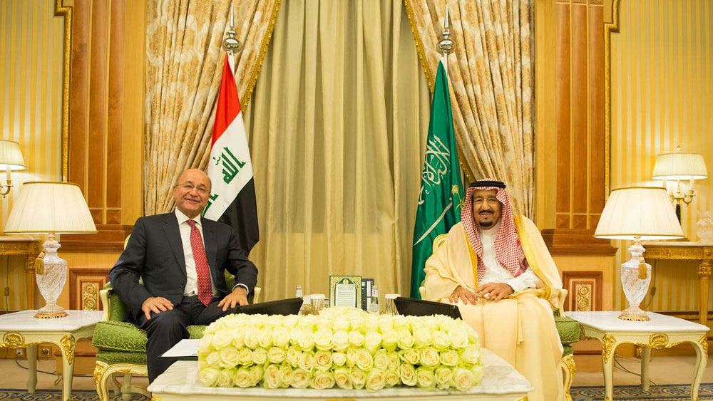Iraqi President Barham Saleh (L) meets with Saudi Arabia's King Salman in Jeddah, on November 18. (Iraqi Presidency Media Office via AFP)