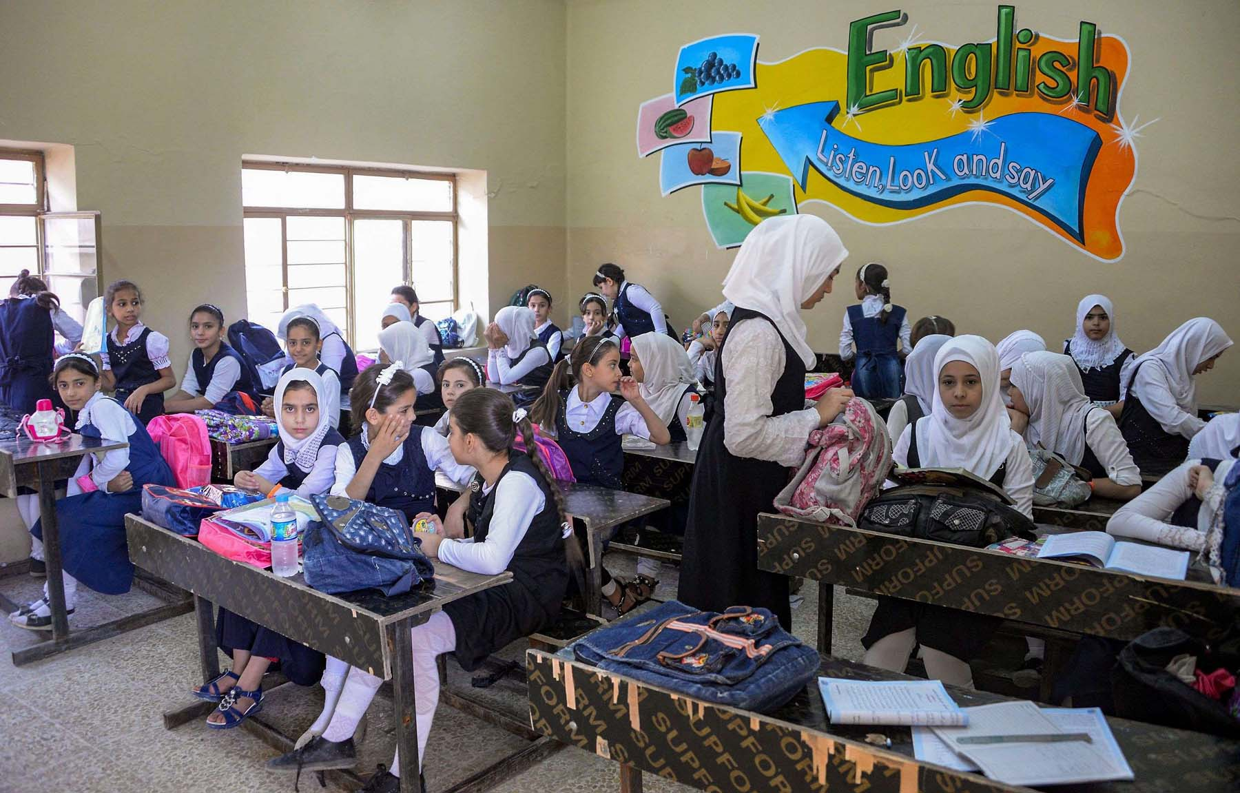 Iraqi schoolgirls attend an English class at a school in western Mosul. (AFP)