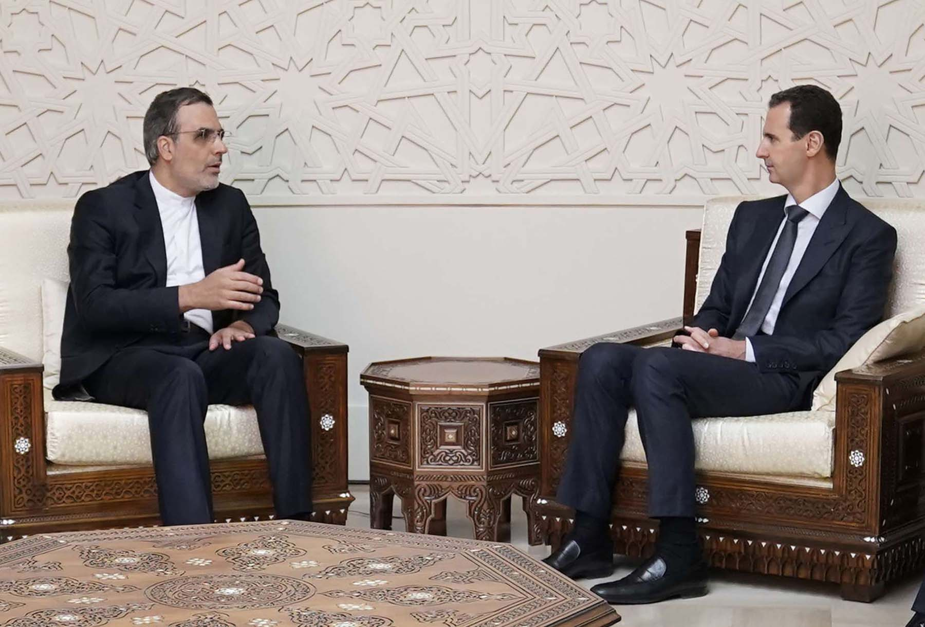 Syrian President Bashar Assad (R) meets with Iranian Assistant Foreign Minister for Arab and African Affairs Hussein Gabri Ansari in Damascus, on November 12. (AFP)