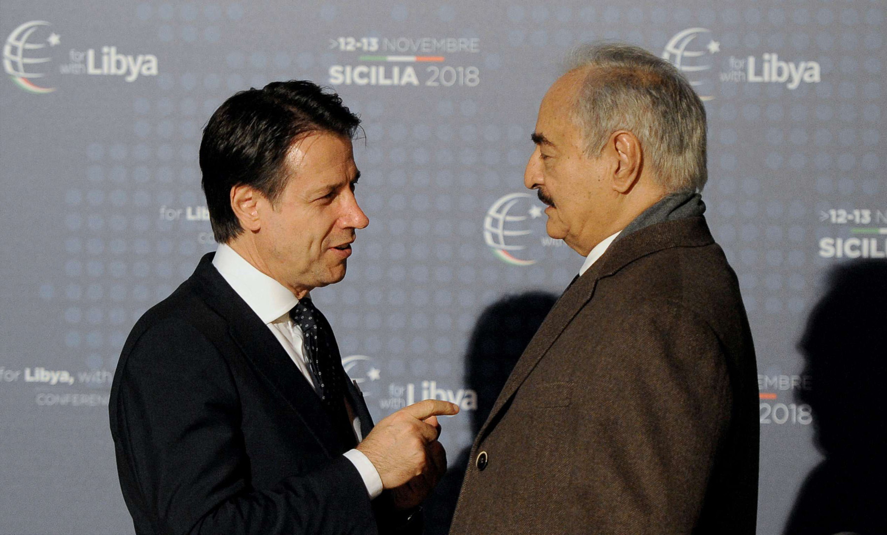 Italian Prime Minister Giuseppe Conte (L) and Libyan Field-Marshal Khalifa Haftar at the venue of the international conference on Libya in Palermo, on November 12. (Reuters)