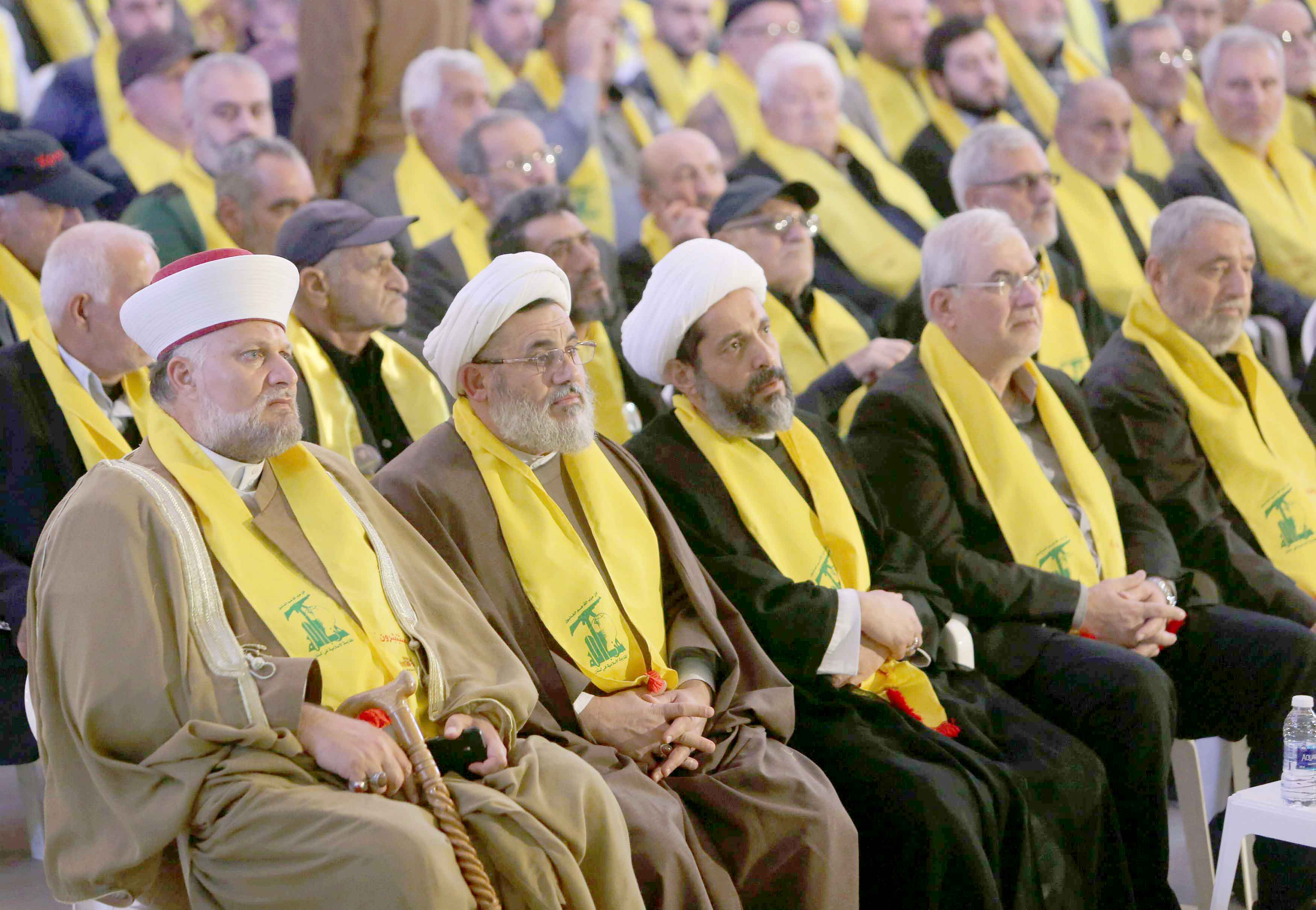 Complex agenda. Religious figures listen to Hezbollah Secretary-General Hassan Nasrallah as he addresses his supporters via a screen in Nabatiyeh, November 10. (Reuters)