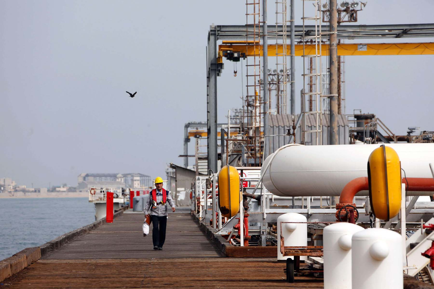 An Iranian worker walks the platform of an oil facility in the Khark Island.                           (AFP)