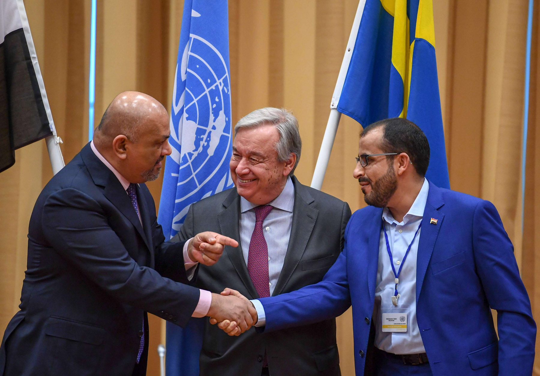 'First step'. Yemeni Foreign Minister Khaled al-Yaman (L) shakes hands with head of Houthi delegation Mohammed Abdulsalam (R) while UN Secretary-General Antonio Guterres looks on during the Yemen peace talks closing news conference in Rimbo, north of Stockholm, December 13.(AFP)