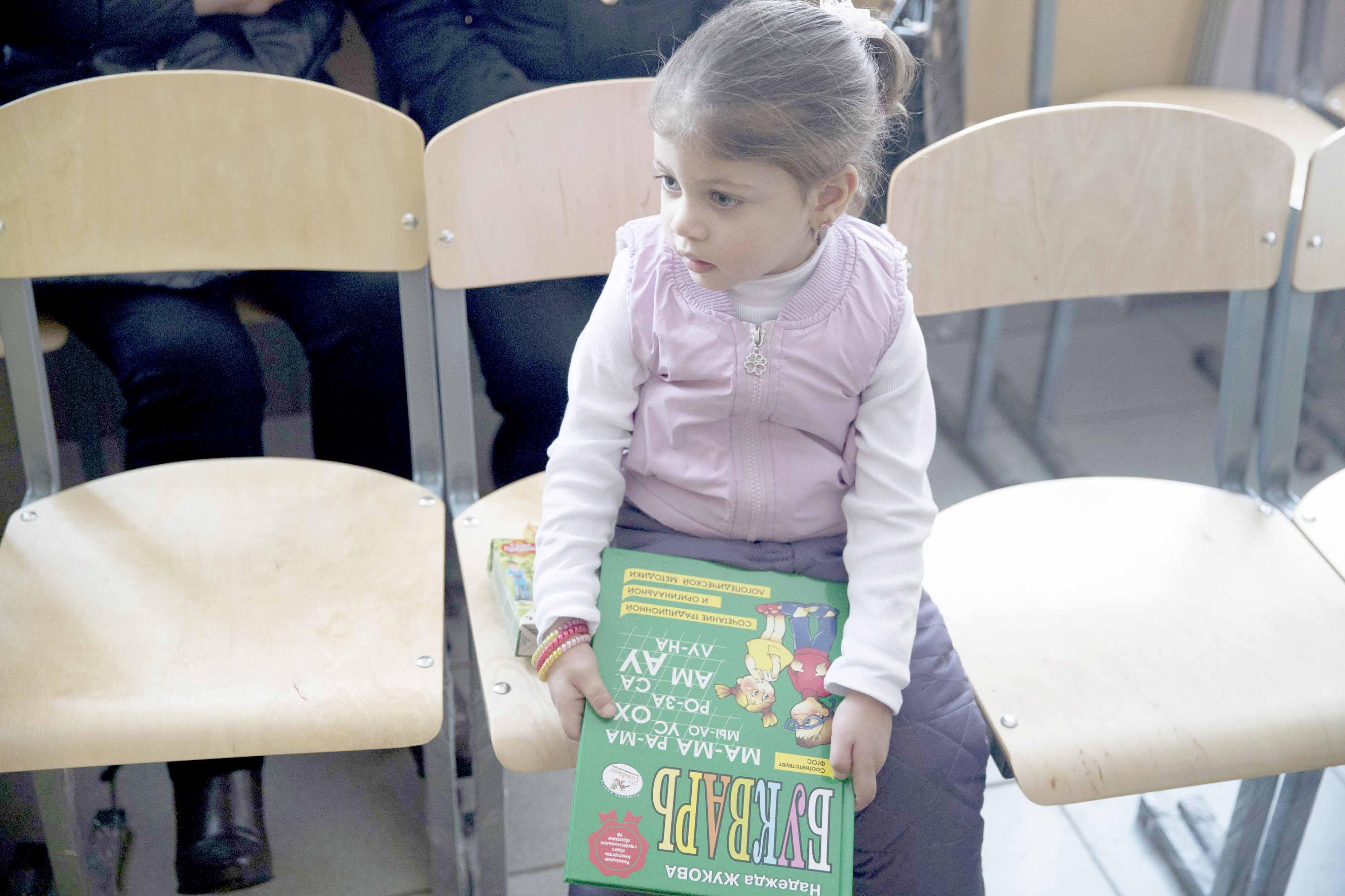 Educational outreach. A Syrian refugee girl holds a Russian ABC-book during a meeting of Syrian refugees in Losino-Petrovsky, about 50km north-east of Moscow.  (AP)