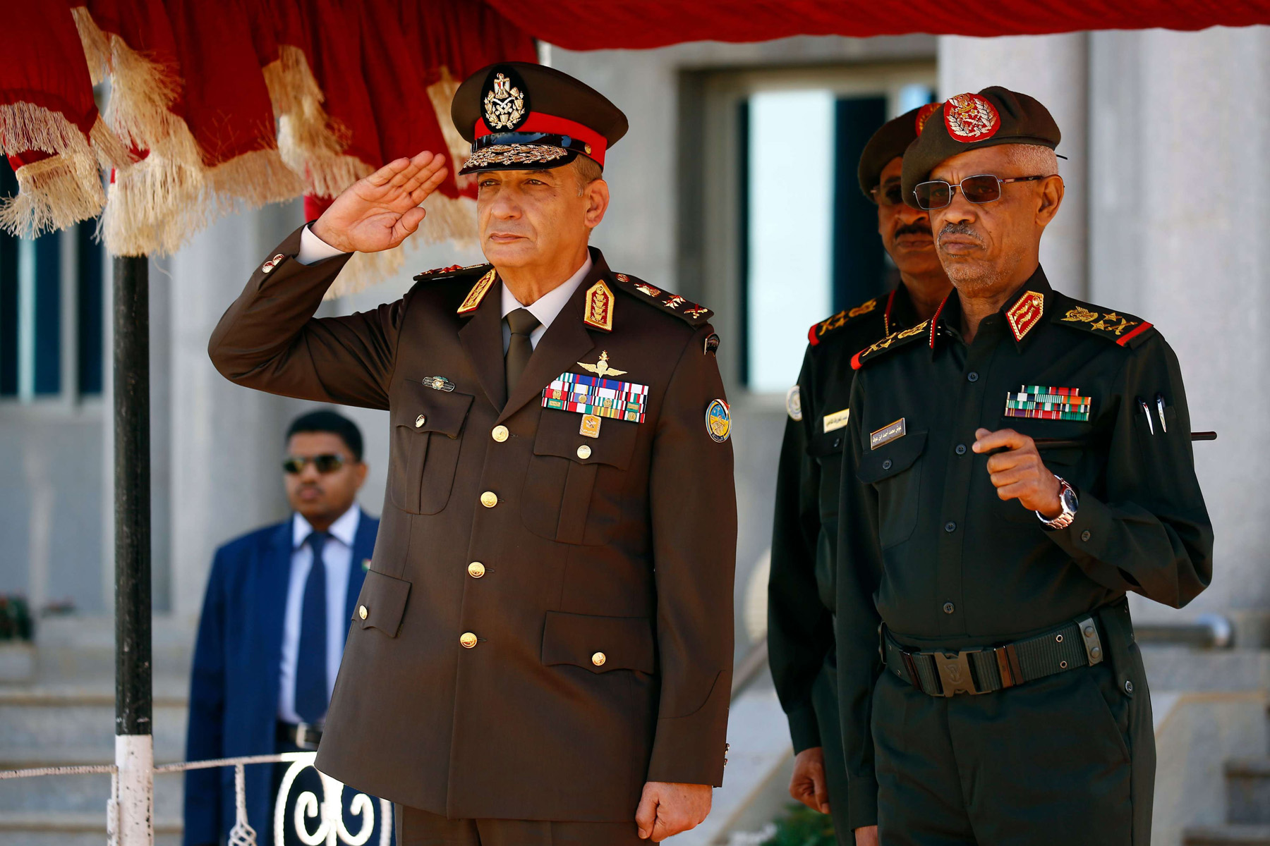 Questions remain. Egyptian Defence Minister Mohamed Ahmed Zaki (L) and his Sudanese counterpart Awad Ibn Ouf in Khartoum, November 25. (AFP)