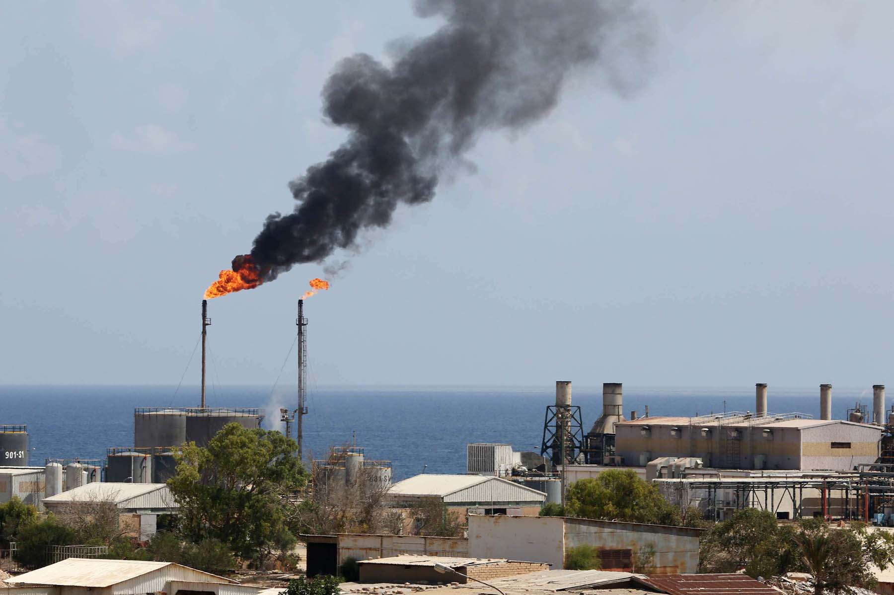 Shifting dynamics.  A general view of the Zawiya oil installation in Libya. (AFP)