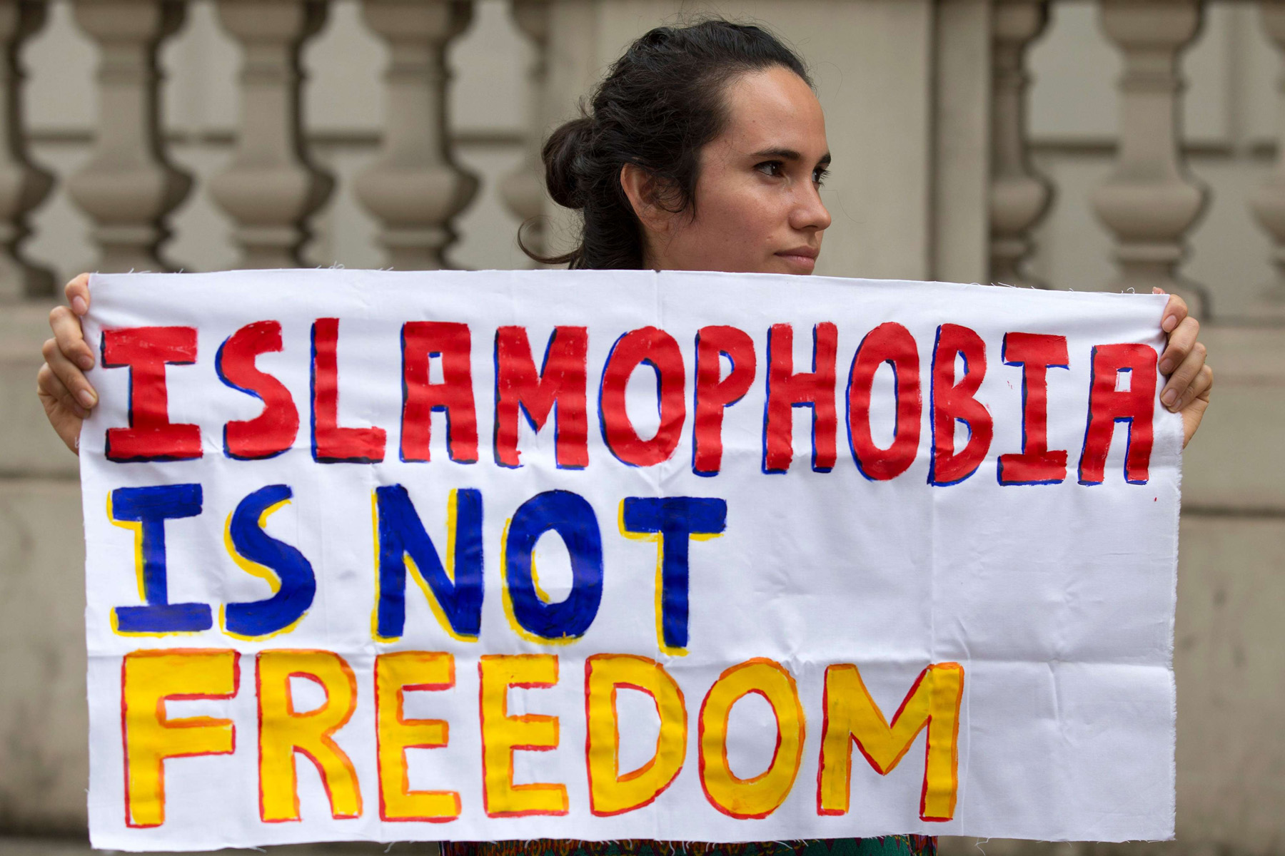 Words matter. A protester participates in an anti-Islamophobia demonstration in London. 				                 (AFP)
