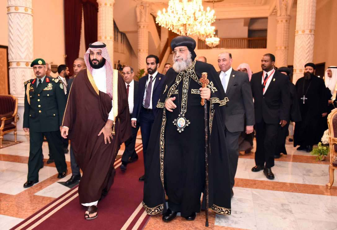 Coptic Orthodox Pope Tawadros II (C-R) and Saudi Crown Prince Mohammed bin Salman bin Abdulaziz (C-L) at the Cathedral of Abbasiya in Cairo, last March. (AFP)