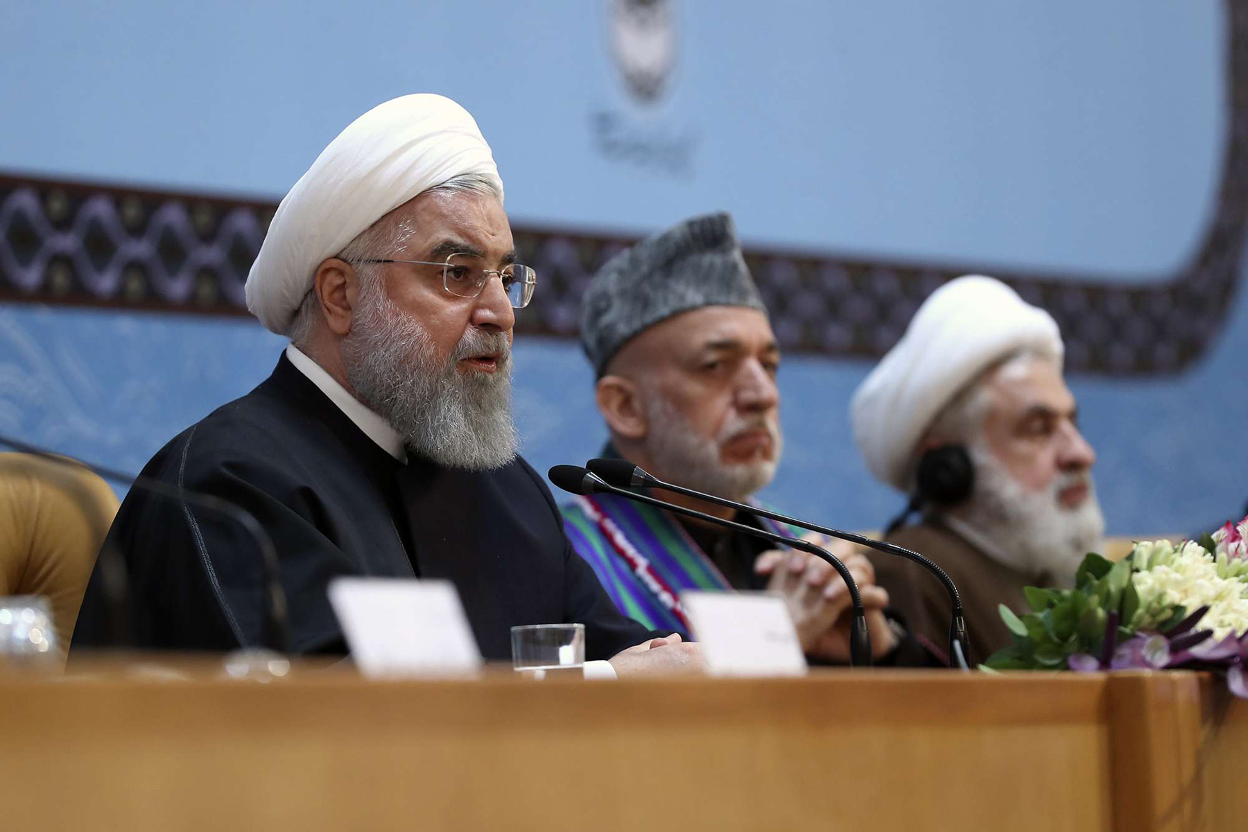 Torch bearer of division. (L-R) Iranian President Hassan Rohani speaks as former President of Afghanistan Hamid Karzai and Deputy Chief of Hezbollah Sheikh Naim Qassem listen during the 32nd annual Islamic Unity Conference in Tehran, November 24.  (Iranian Presidency)
