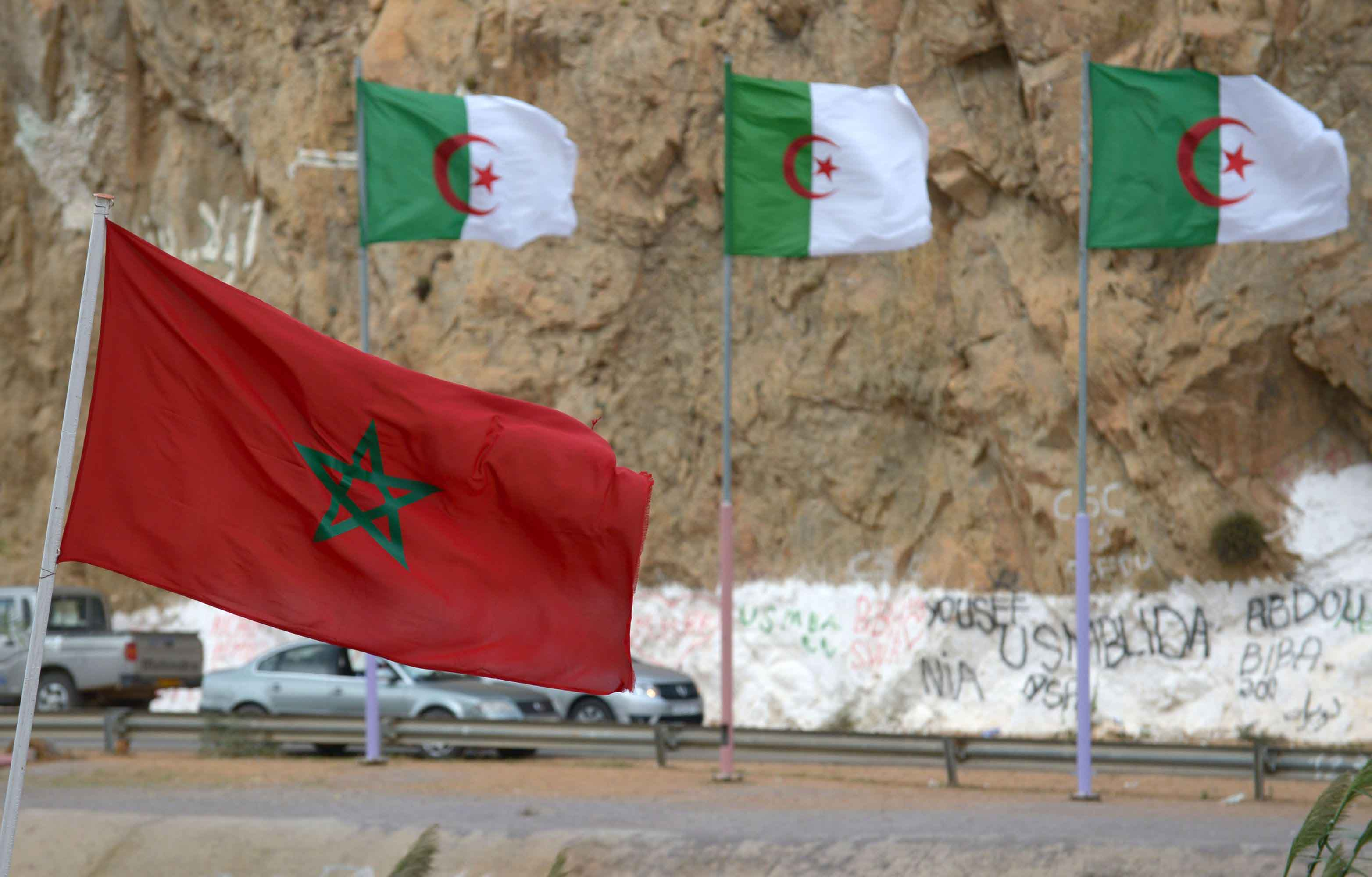 Moroccan and Algerian flags in Saidia at the border between the two countries. (AFP)