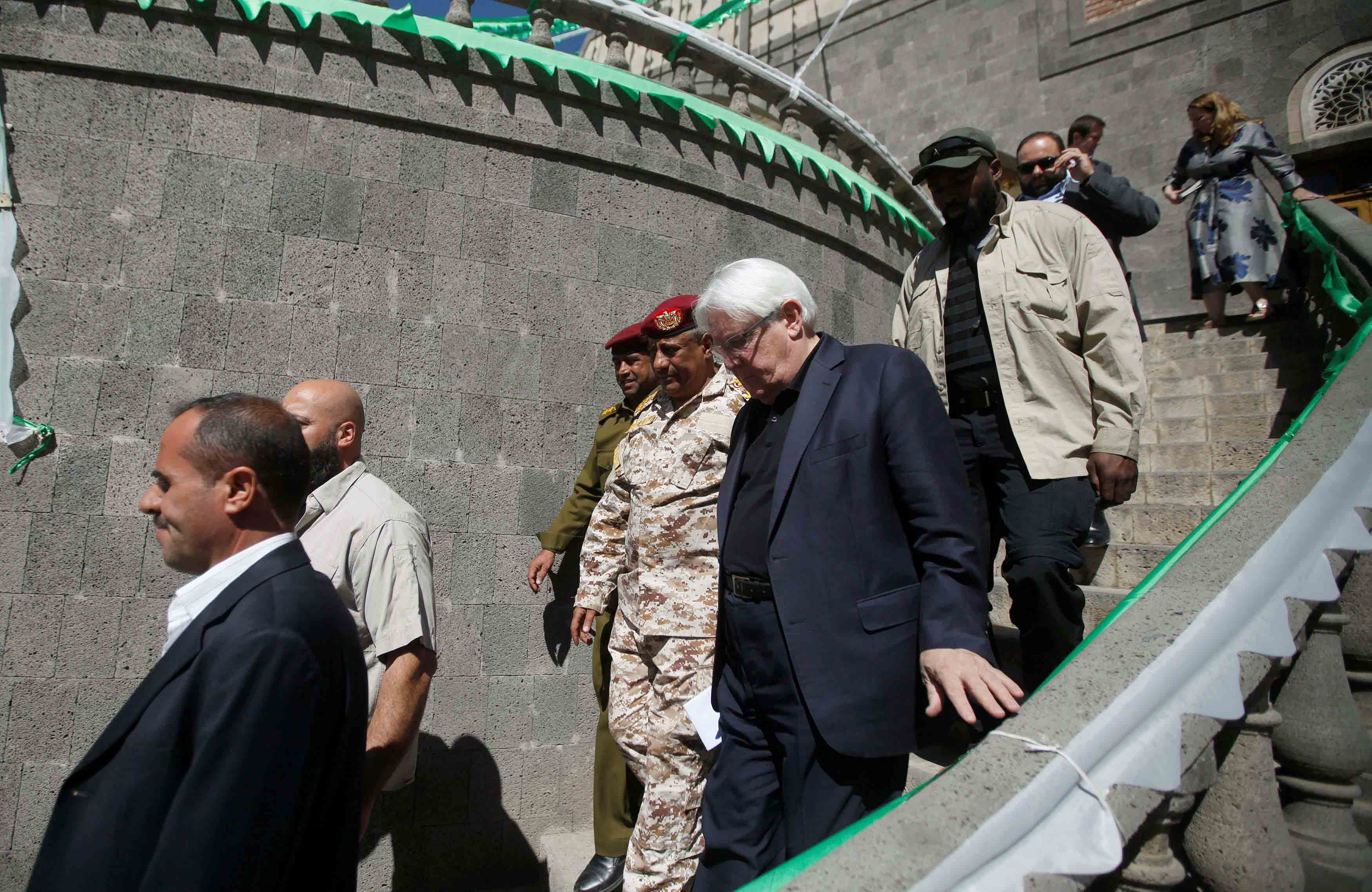 UN Special Envoy to Yemen Martin Griffiths (C) walks after meeting with Mohamed Ali al-Houthi, head of the Houthi Supreme Revolutionary Committee in Sana'a, November 24. (Reuters)