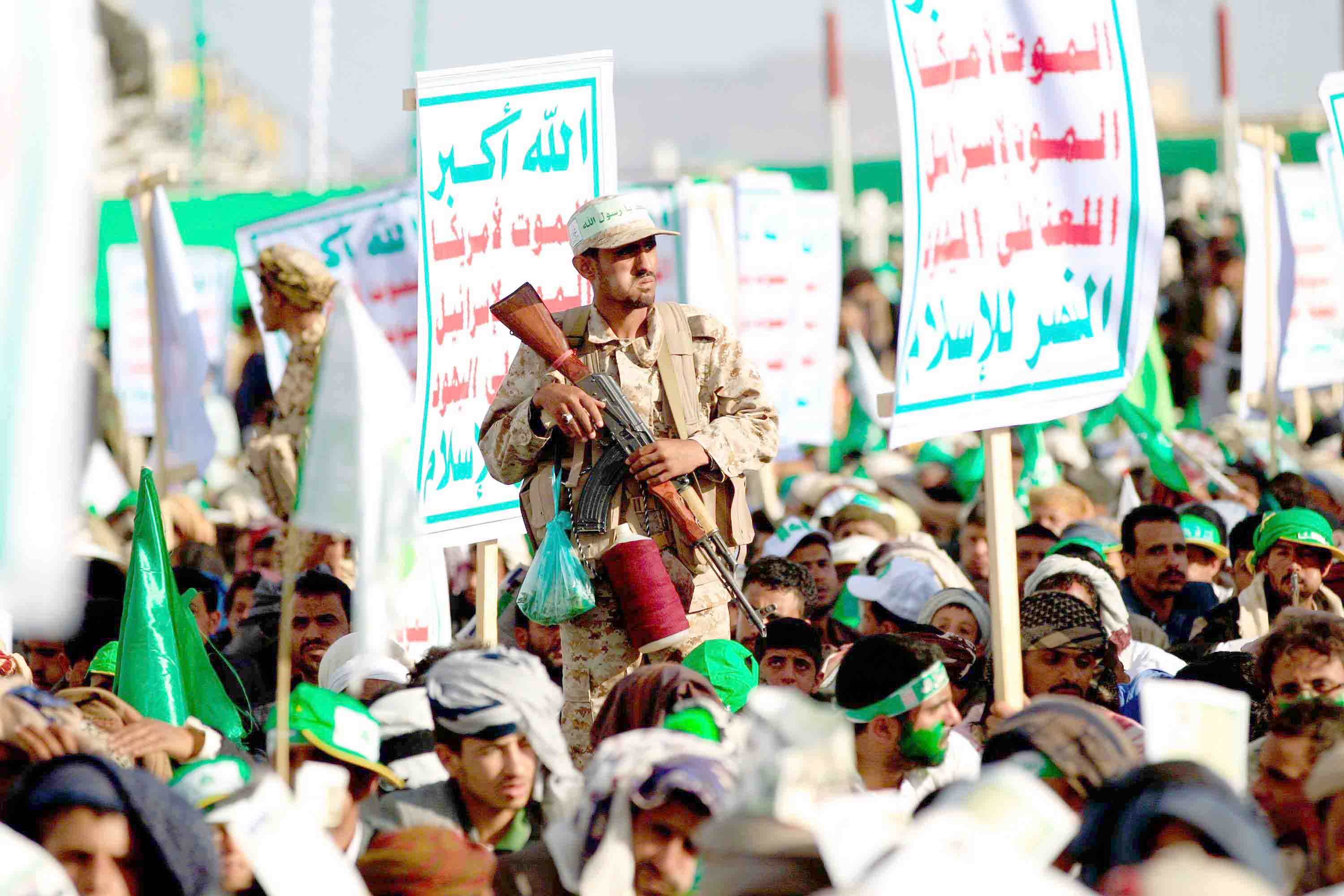 A Houthi fighter secures a rally in Sana'a, on November 20. (AFP)
