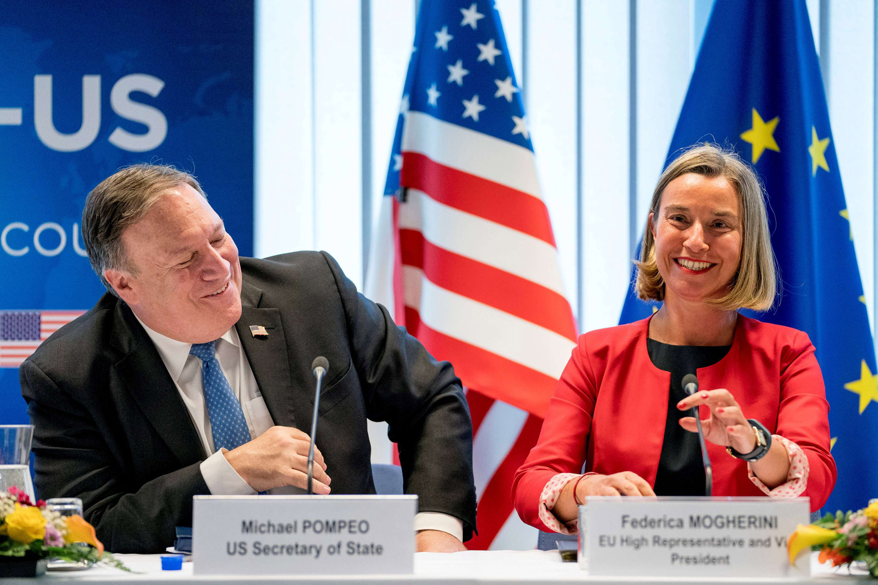US Secretary of State Mike Pompeo (L) and European Union foreign policy chief Federica Mogherini speak at a meeting in Brussels, last July. (Reuters)
