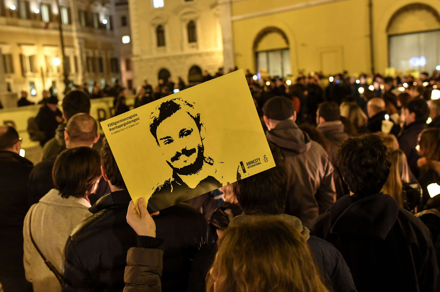 Back into the spotlight. A 2017 file picture shows activists holding a picture of Giulio Regeni and candles as they take part in a demonstration in Rome.   (AFP)