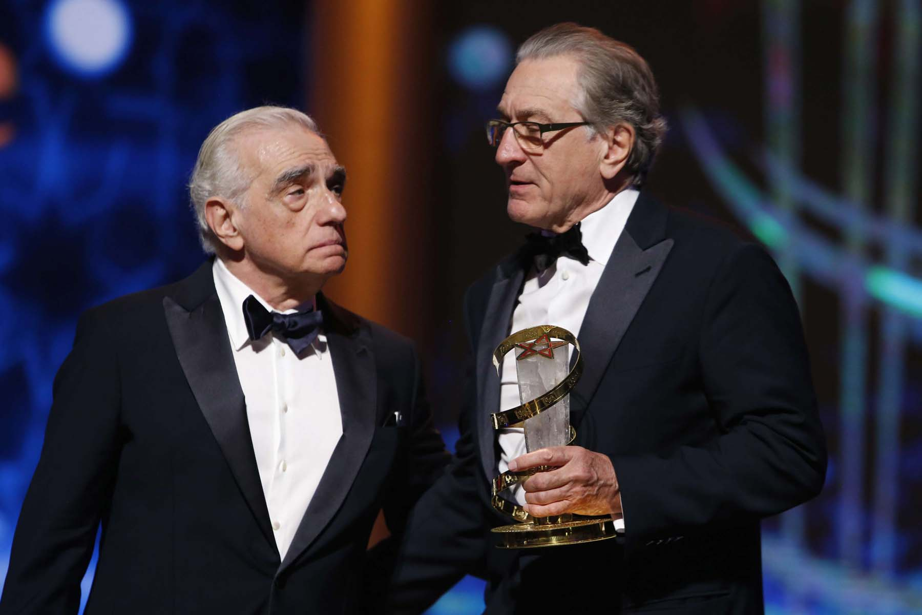 Actor Robert De Niro (R) poses after receiving a tribute award from US director Martin Scorsese during the 17th Marrakech International Film Festival, December 1. (AP)