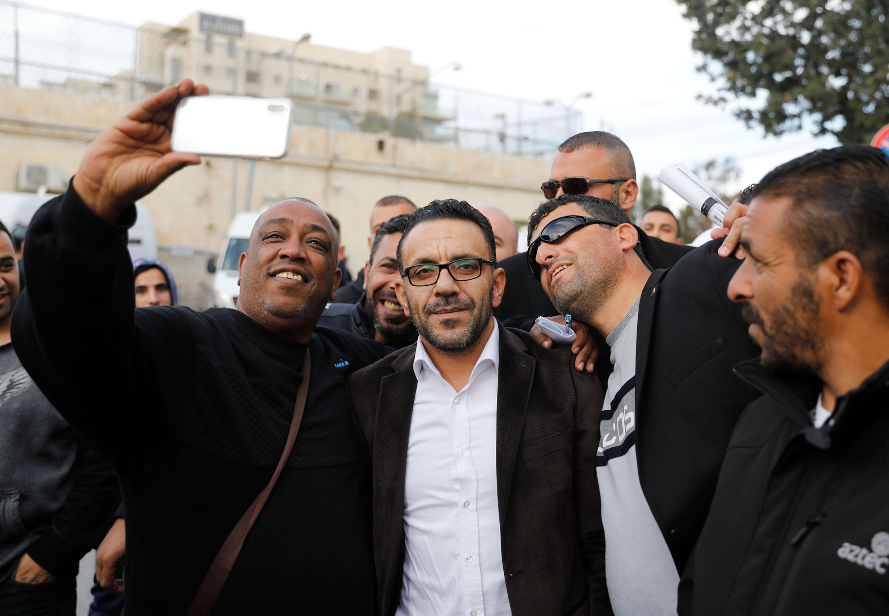 From detention to house arrest. Palestinian Governor of Jerusalem Adnan Ghaith (2nd-L) meets relatives after his release from detention in Jerusalem, December 2. 				    (AFP)