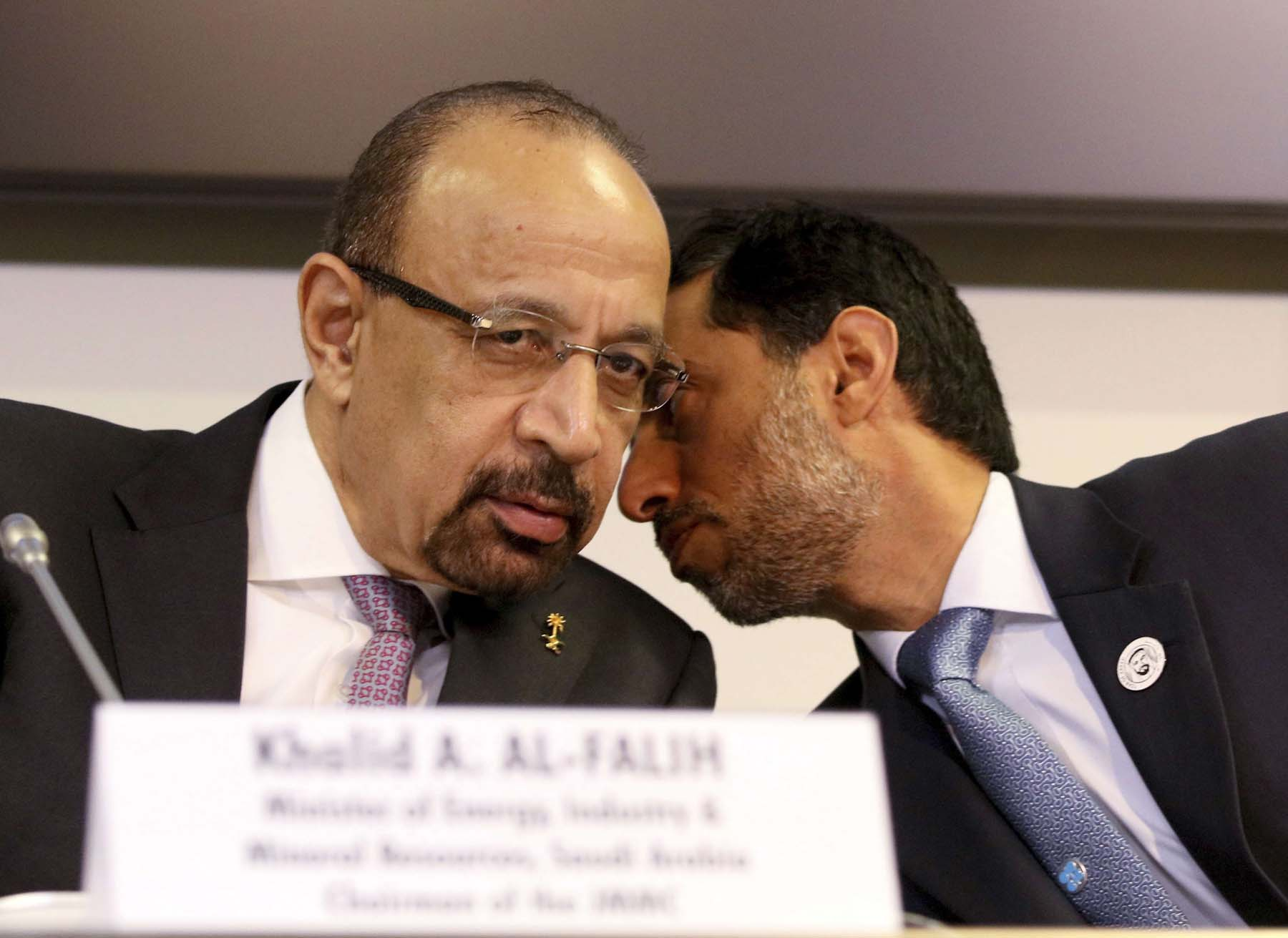 Saudi Oil Minister Khalid al-Falih (L) and Emirati Minister of Energy Suhail Mohamed Al Mazrouei during a news conference after OPEC meeting in Vienna, December 7. (AP)