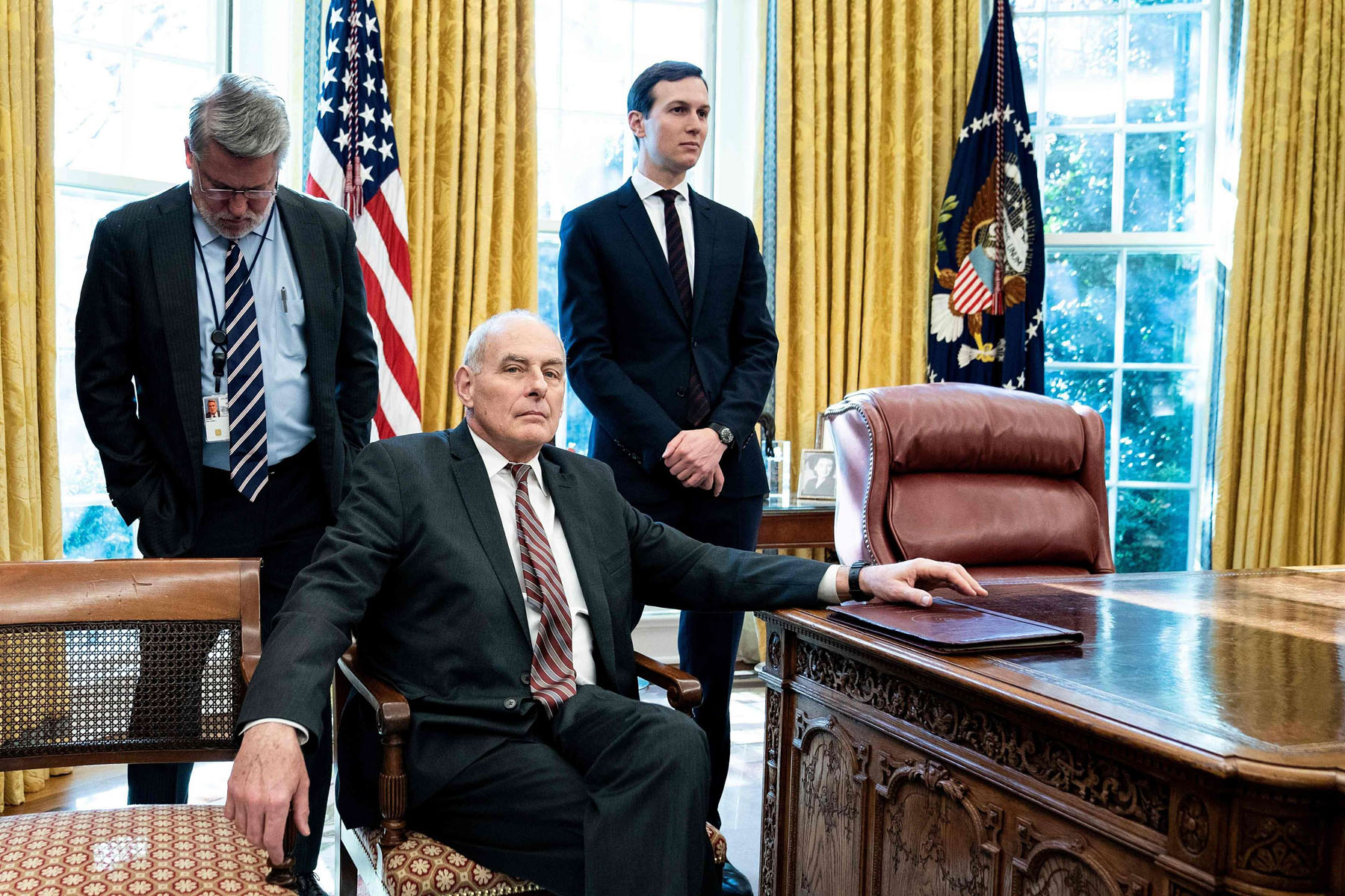 White House communications director Bill Shine (L), White House Chief of Staff John Kelly (C), and Senior Advisor Jared Kushner in the Oval Office of the White House, December 11. (AFP)