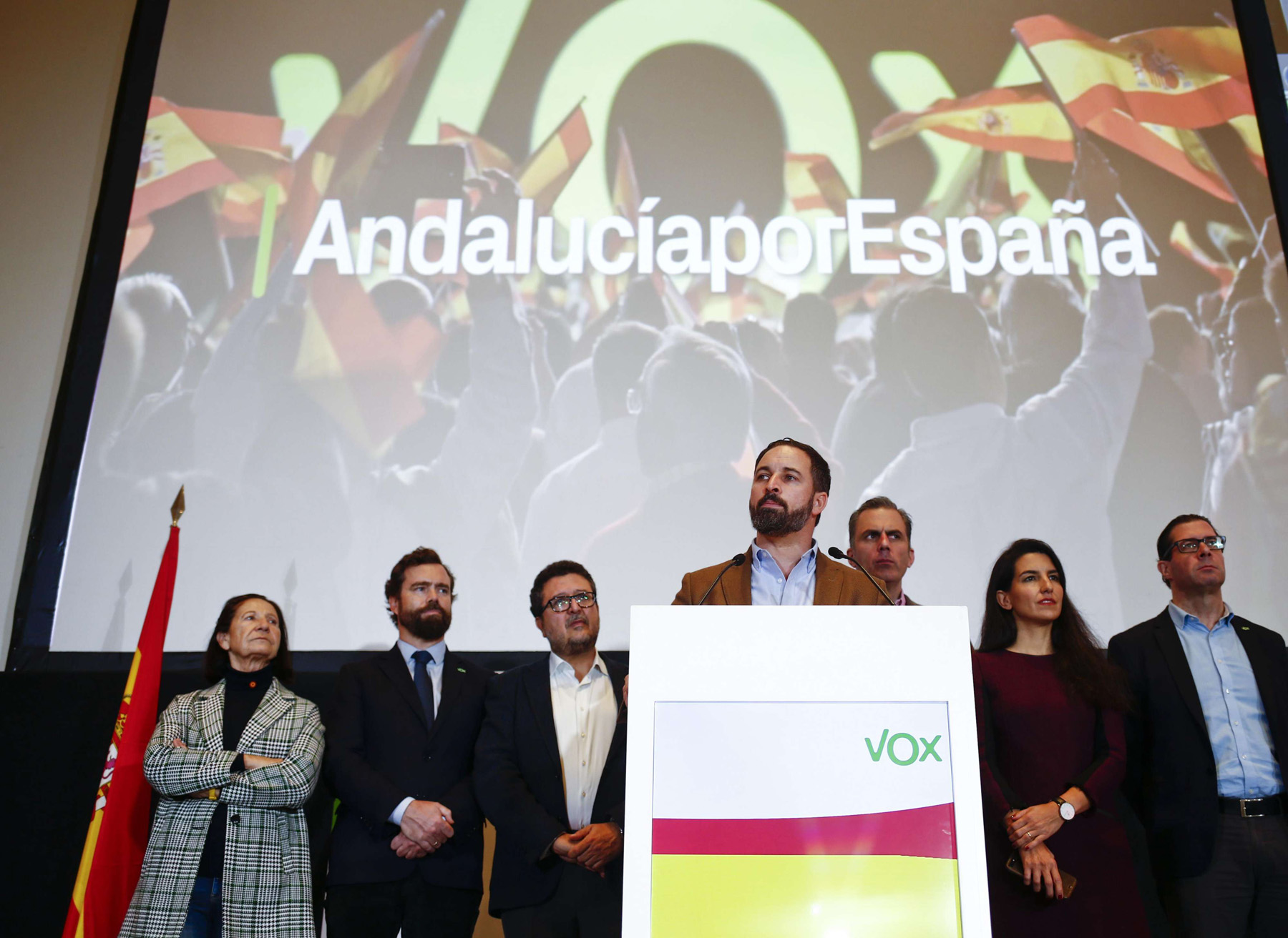 Spain's far-right Vox party leader Santiago Abascal (C-R) speaks during a news conference in Seville, December 3. (Reuters)