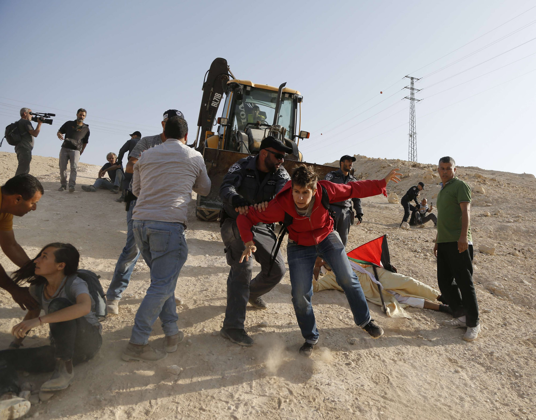 Israeli police scuffle with activists in the West Bank Bedouin village of Khan al-Ahmar which is slated for demolition, October 15. (AP)