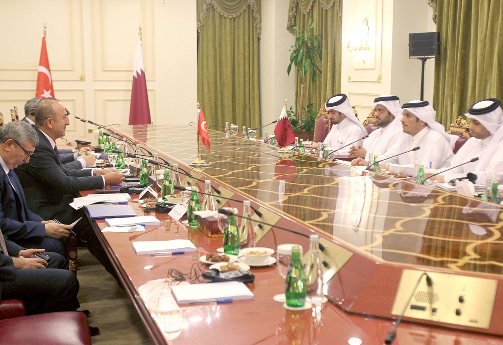 Troubling entente. Qatari Foreign Minister Mohammed bin Abdulrahman bin Jassim al-Thani meets with Turkish Foreign Minister Mevlut Cavusoglu in Doha, last November. (Reuters)