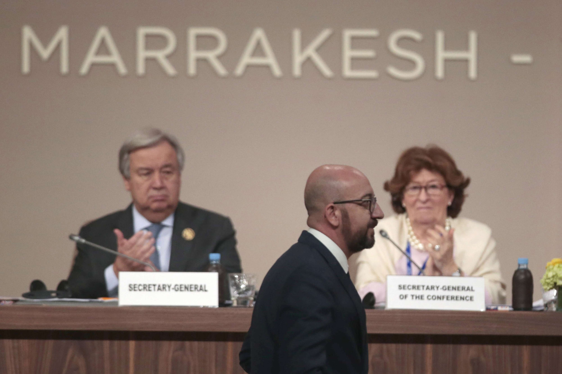 Belgian Prime Minister Charles Michel walks past UN Secretary-General Antonio Guterres (L) and Special Representative of the United Nations Secretary-General for International Migration Louise Arbor during the opening session of a UN Migration Conference in Marrakech, December 10. (AP)
