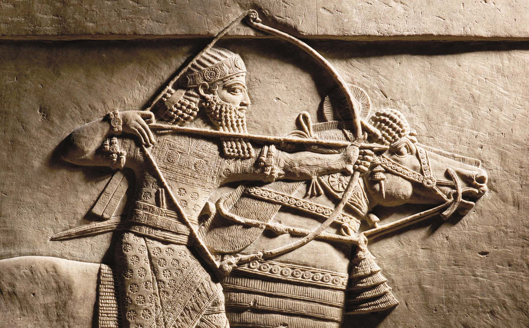 A sculpture shows Ashurbanipal hunting on hosrseback. (British Museum)