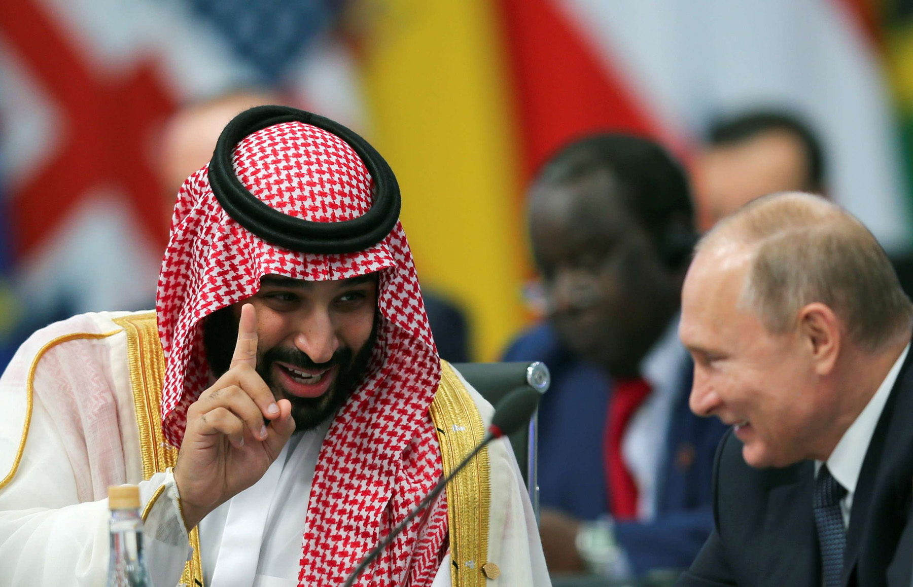 On the world stage. Saudi Crown Prince Mohammed bin Salman bin Abdulaziz (L) speaks with Russian President Vladimir Putin during the opening of the G20 summit in Buenos Aires, November 30.  (Reuters)