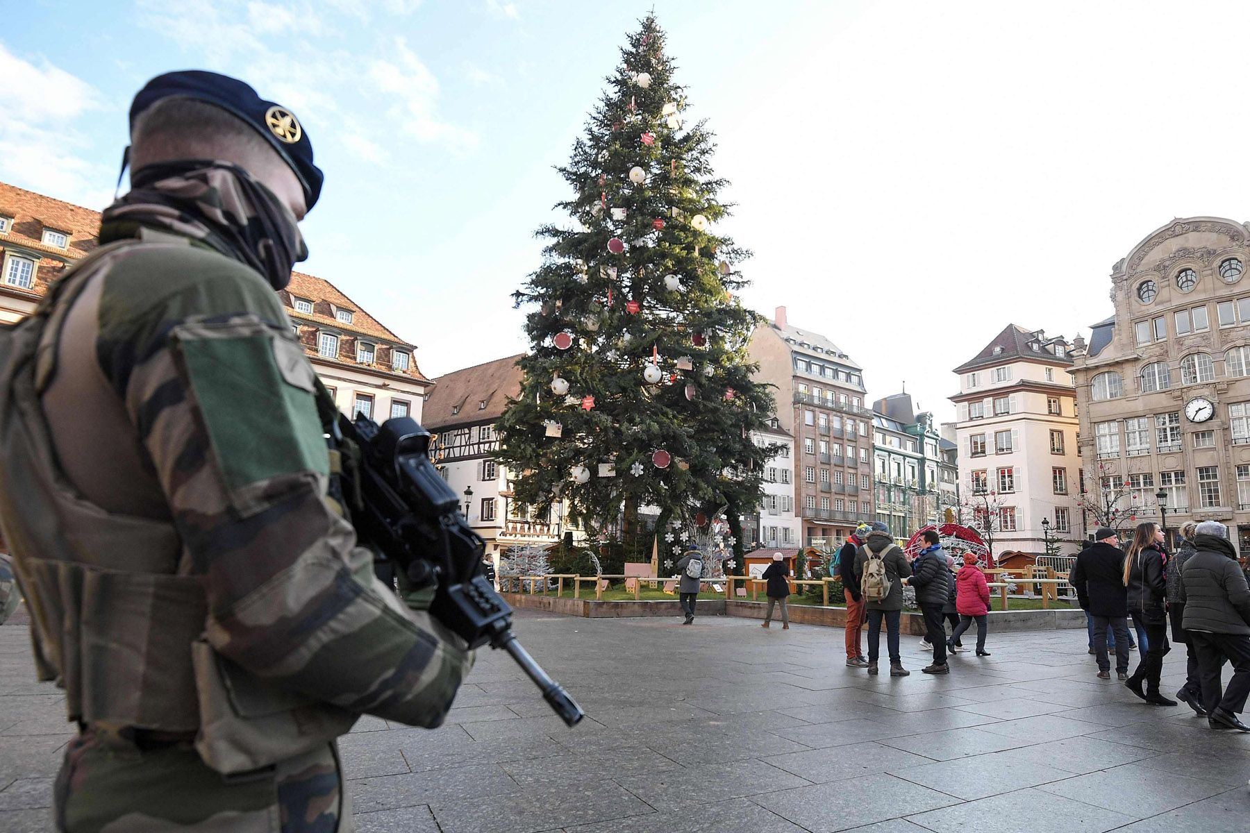 A French soldier from the Sentinelle security operation stands guard next to the Christmas tree on Place Kleber, in central Strasbourg on December 13, 2018