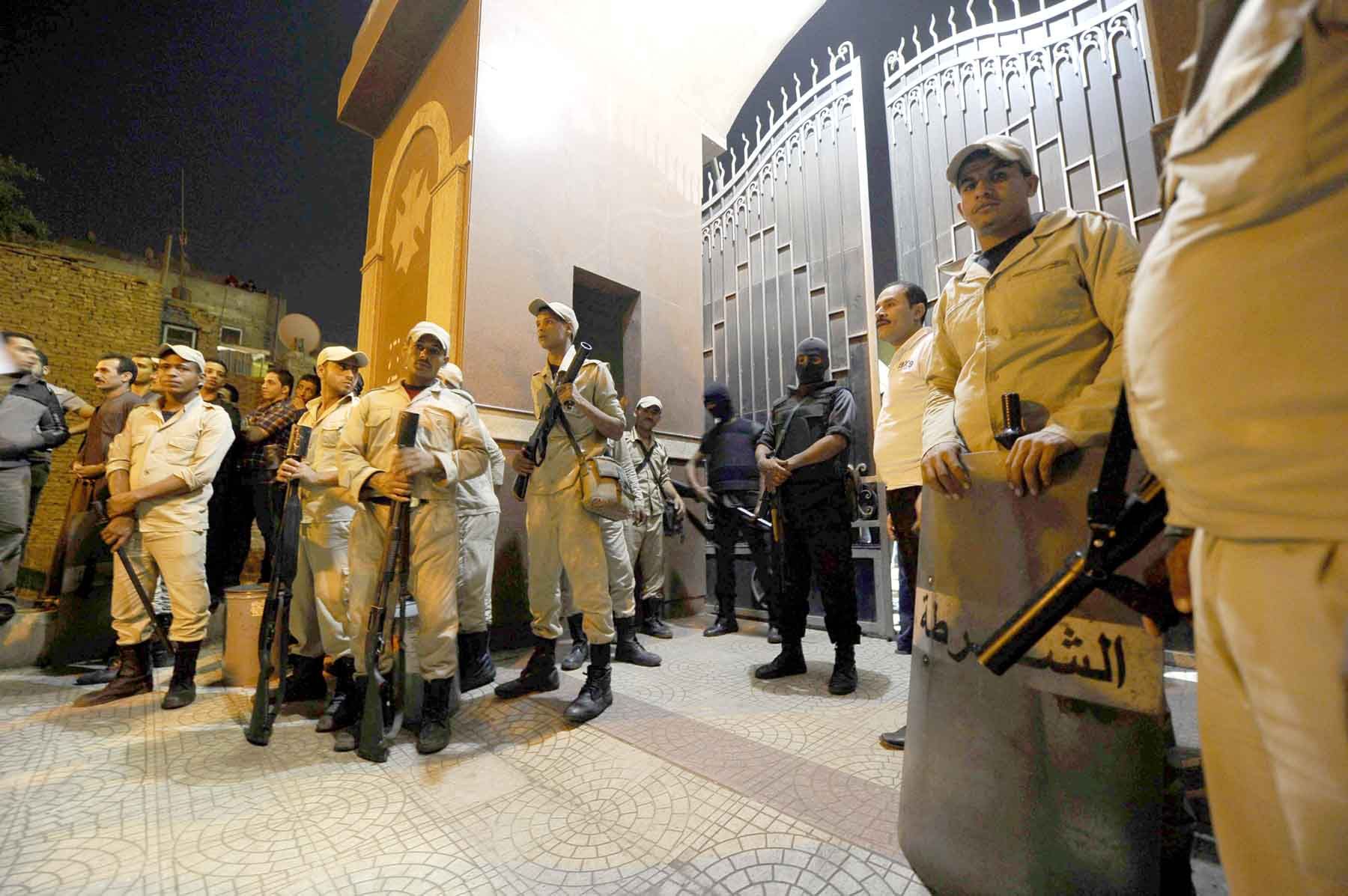 Egyptian security forces stand guard at a Coptic Christian church in the Waraa neighbourhood in Cairo. (AP)