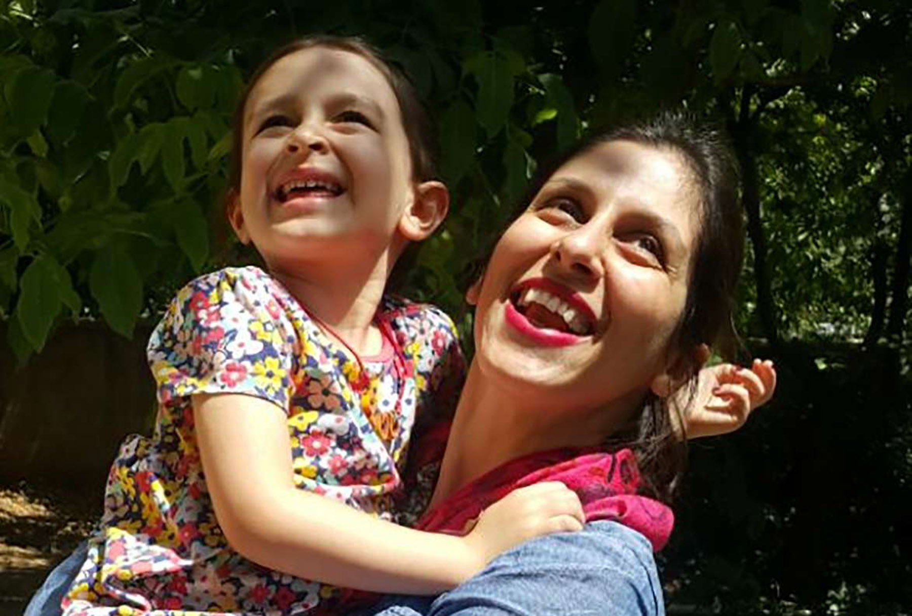 Nazanin Zaghari-Ratcliffe embraces her daughter Gabriella in Damavand, Iran,  following her release from prison for three days, last August. (AFP)