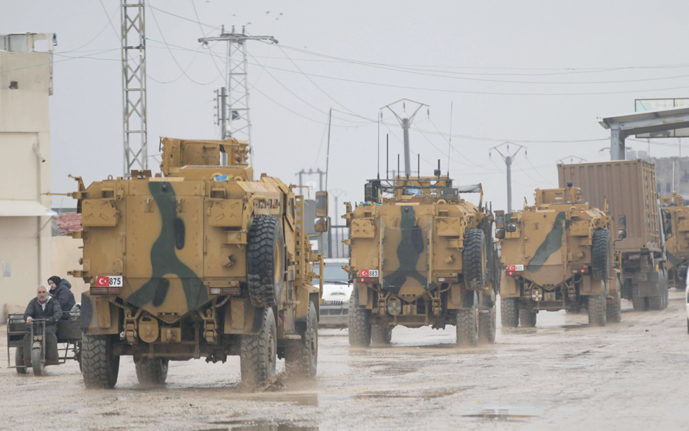 New direction. Turkish military vehicles ride at the Bab el-Salam border crossing between the Syrian town of Azaz and the Turkish town of Kilis, January 1. (Reuters)