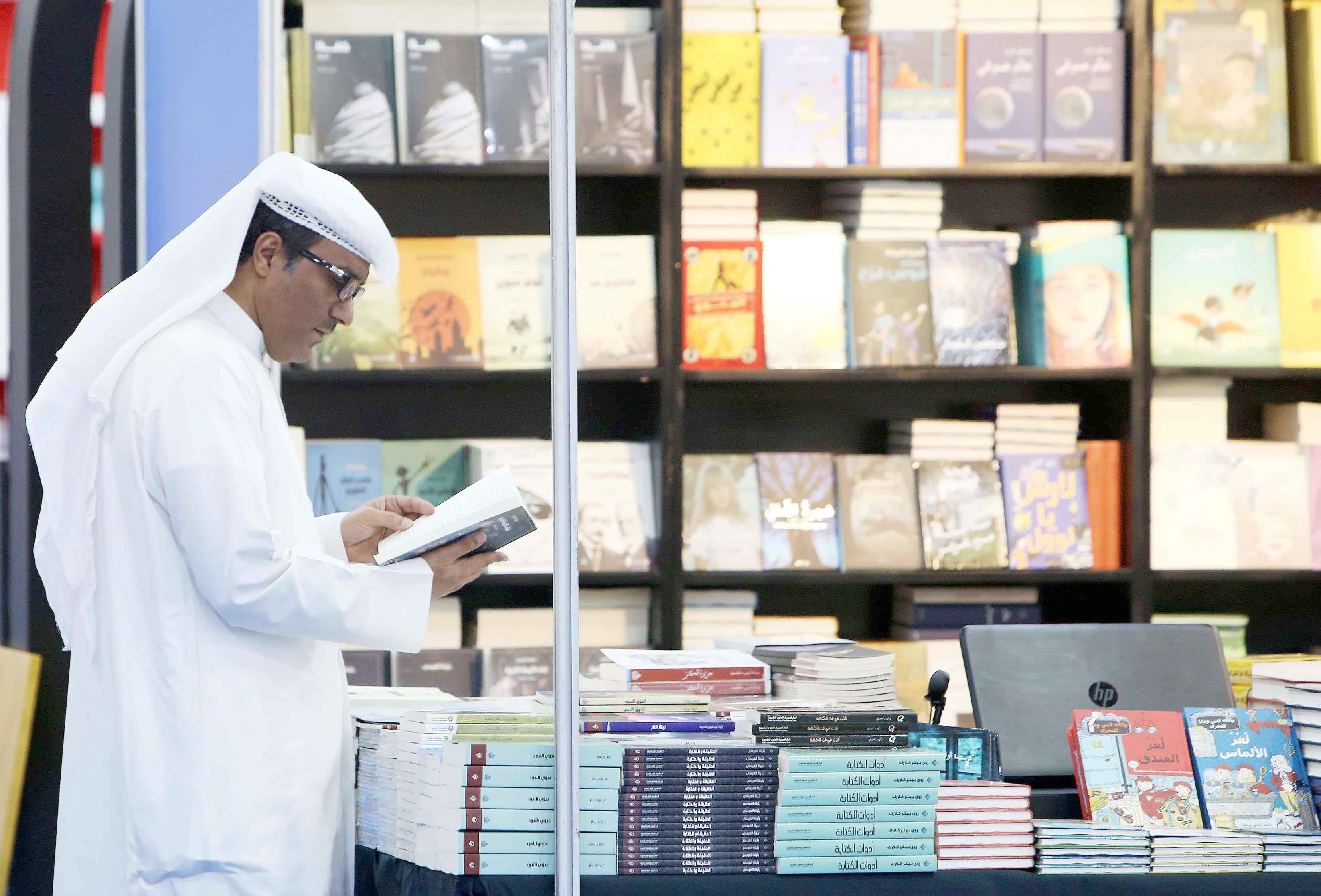 Backward in coming forward. A Kuwaiti man reads a book during the 43rd international book fair in Kuwait City, last November. (AFP)