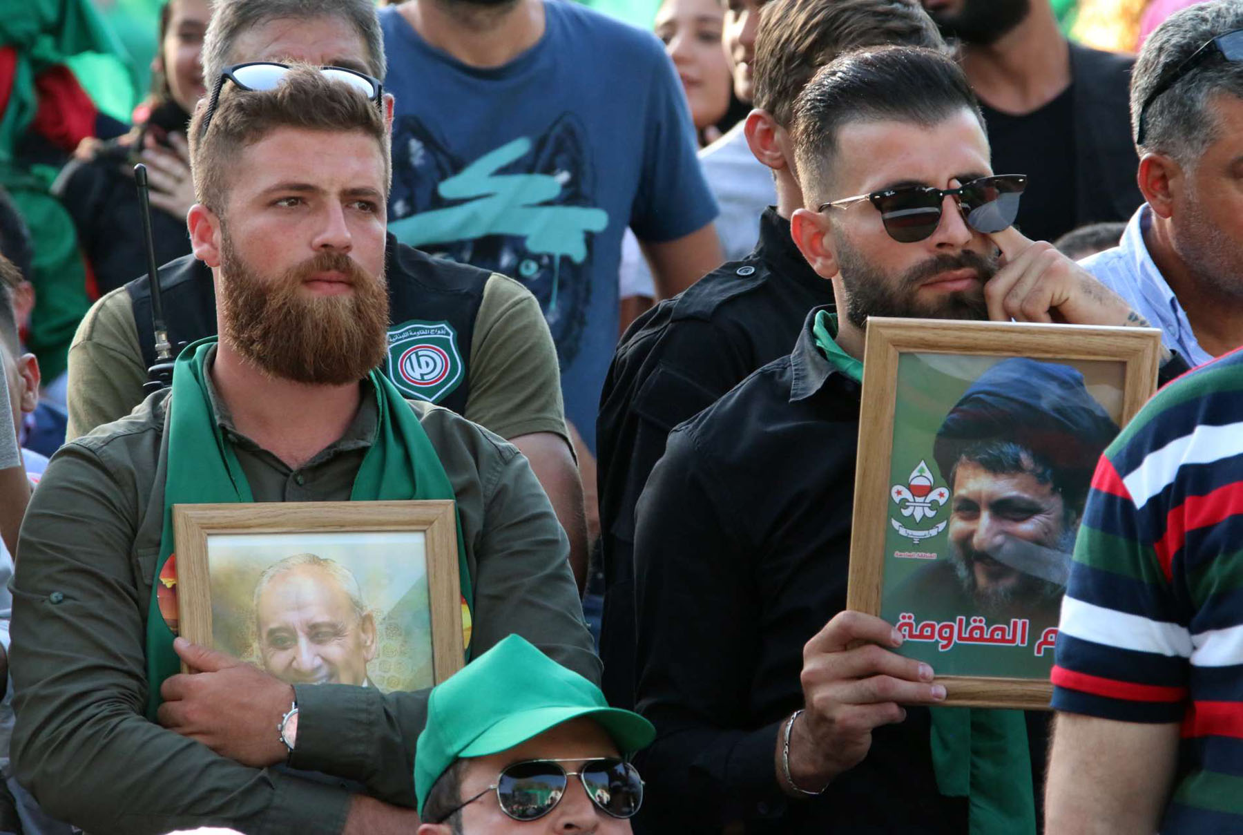 A poke in the eye. An Amal movement supporter holds a picture of Imam Moussa Sadr (R) during a ceremony held in Baalbek, last August. (AFP)