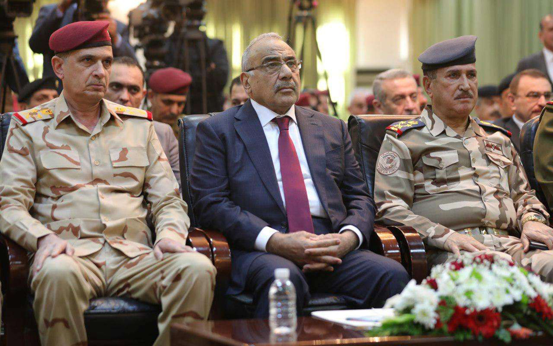 Iraqi Prime Minister Adel Abdul-Mahdi (C) attends a ceremony on the first anniversary of defeating ISIS in Baghdad,  December 10. (Reuters)