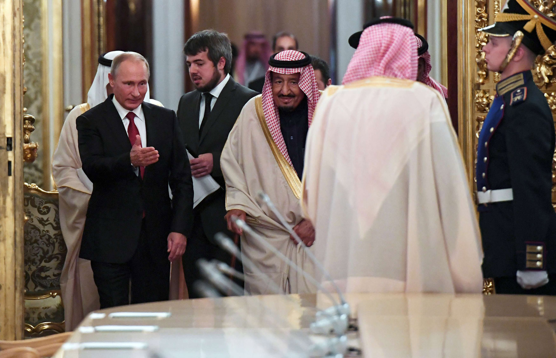 Key alliances. Russian President Vladimir Putin (L) shows the way to Saudi King Salman bin Abdulaziz Al Saud during a meeting at the Kremlin in Moscow, last October. (Reuters)