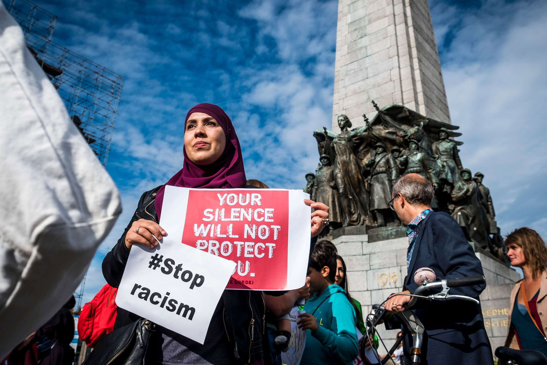 Uphill battle. A Muslim woman holds posters as she protests against 'hate and islamophobia' in Brussels, last September 9. (AFP)