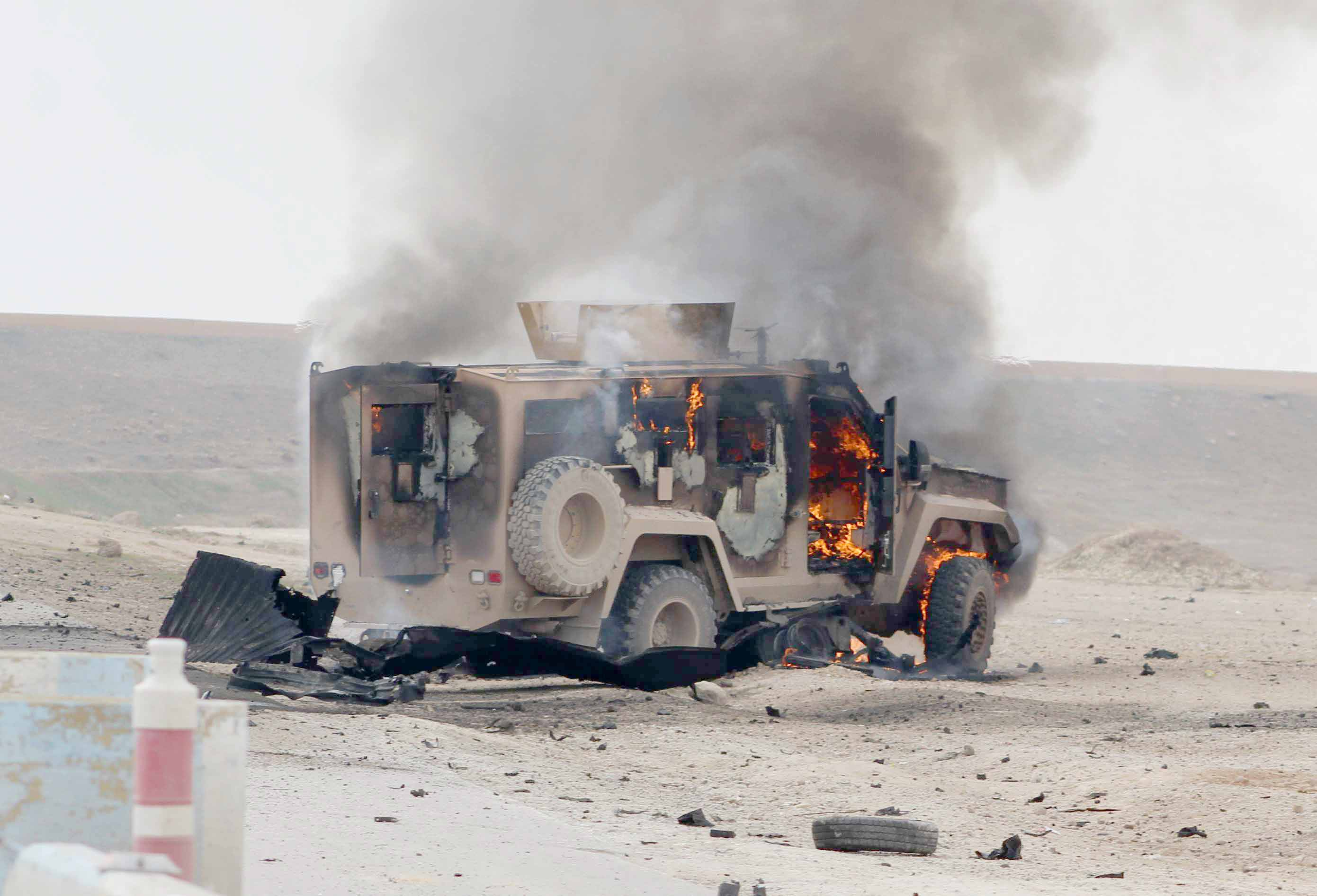 A military vehicle burns at the scene of a suicide car bomb attack in Syria's  north-eastern Hasakah province, January 21. (AFP)