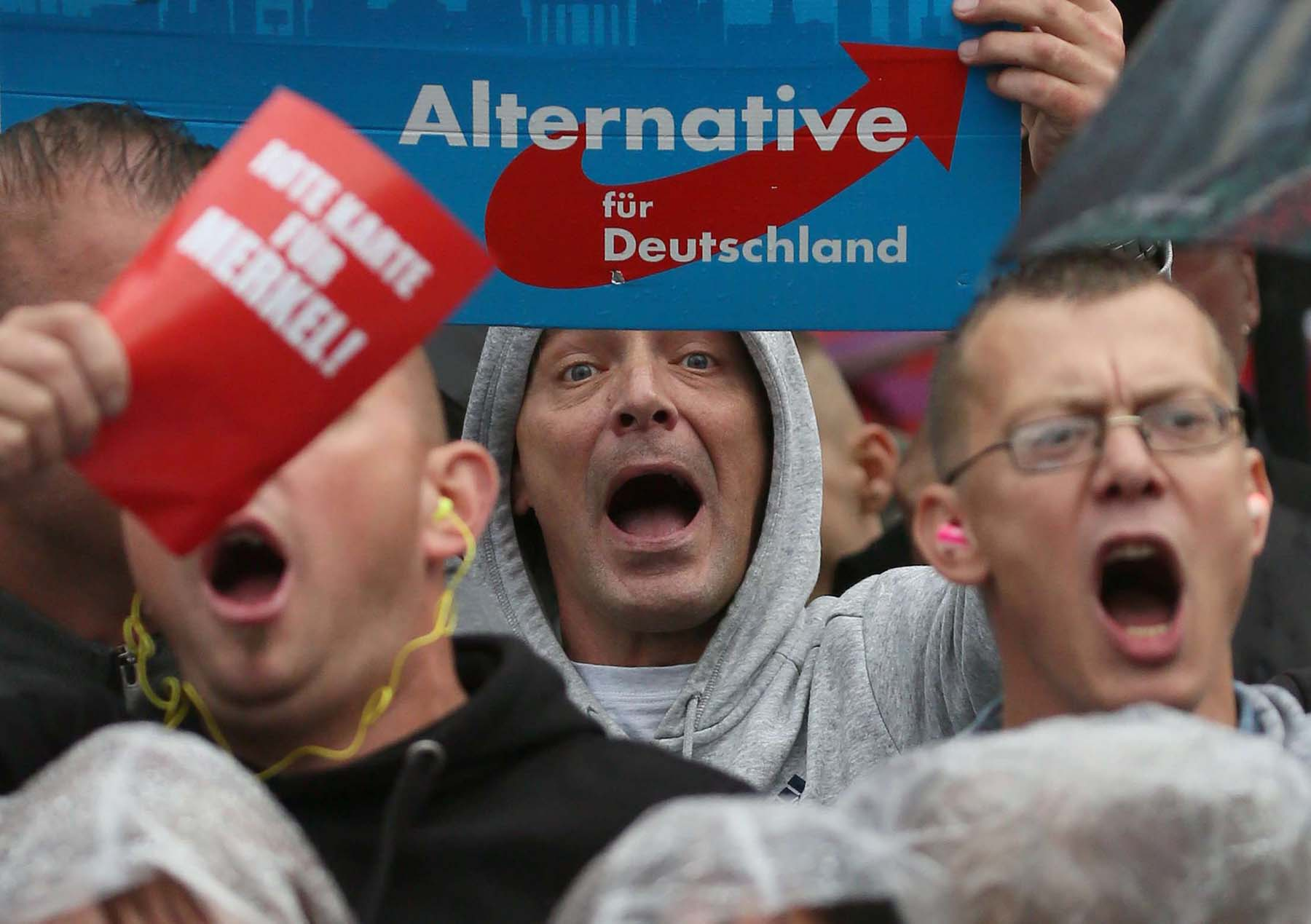 Supporters of the far-right party Alternative for Germany shout slogans in Torgau, Germany.                (Reuters)