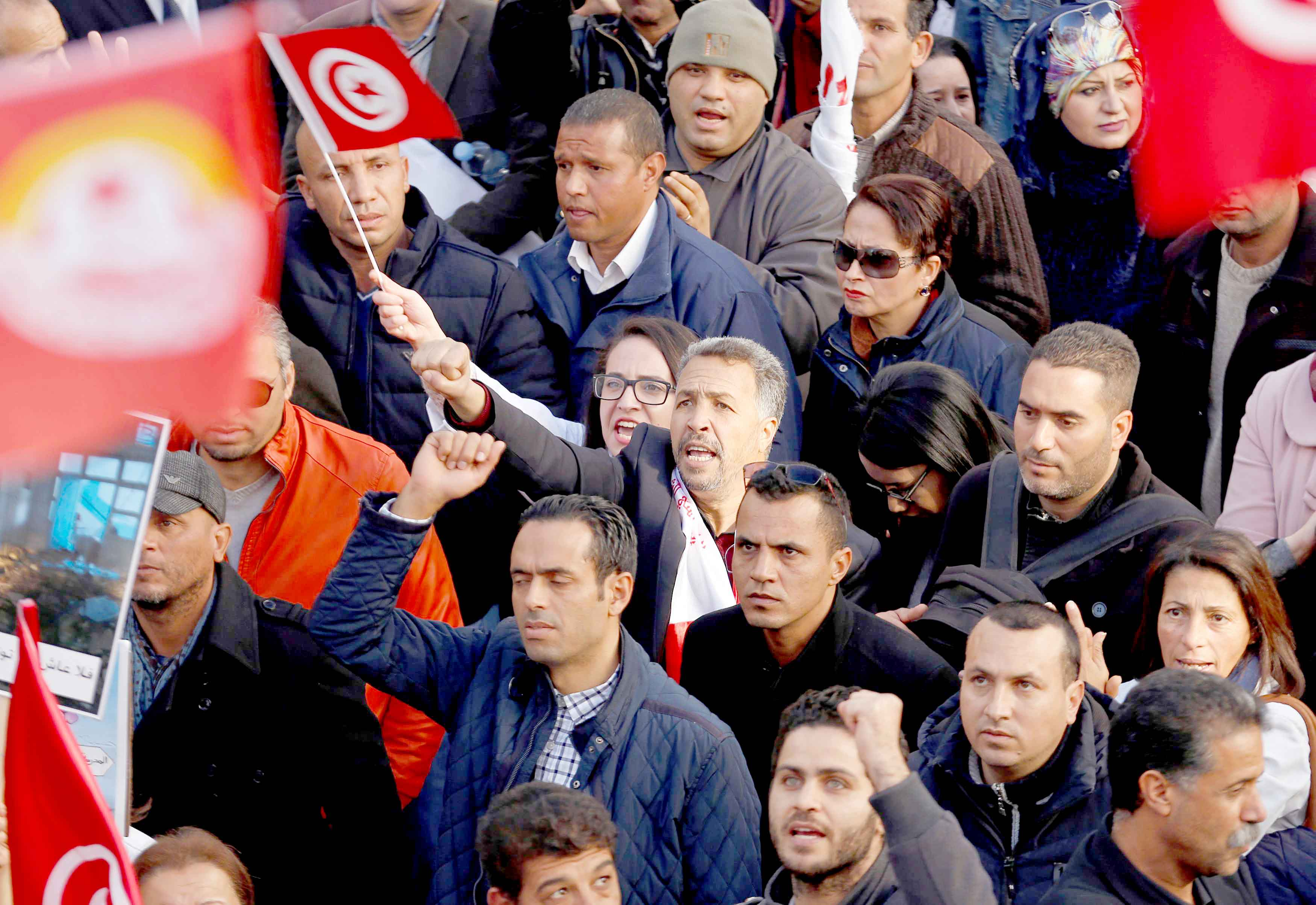 University professors and teachers take part in a protest to demand higher wages in Tunis, December 19. (Reuters)