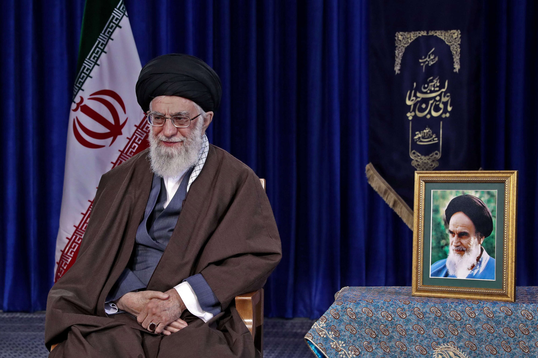 Who's next? Iranian Supreme Leader Ali Khamenei sits next to a picture of the late founder of the Islamic Republic Ayatollah Ruhollah Khomeini, last March.              (AFP)