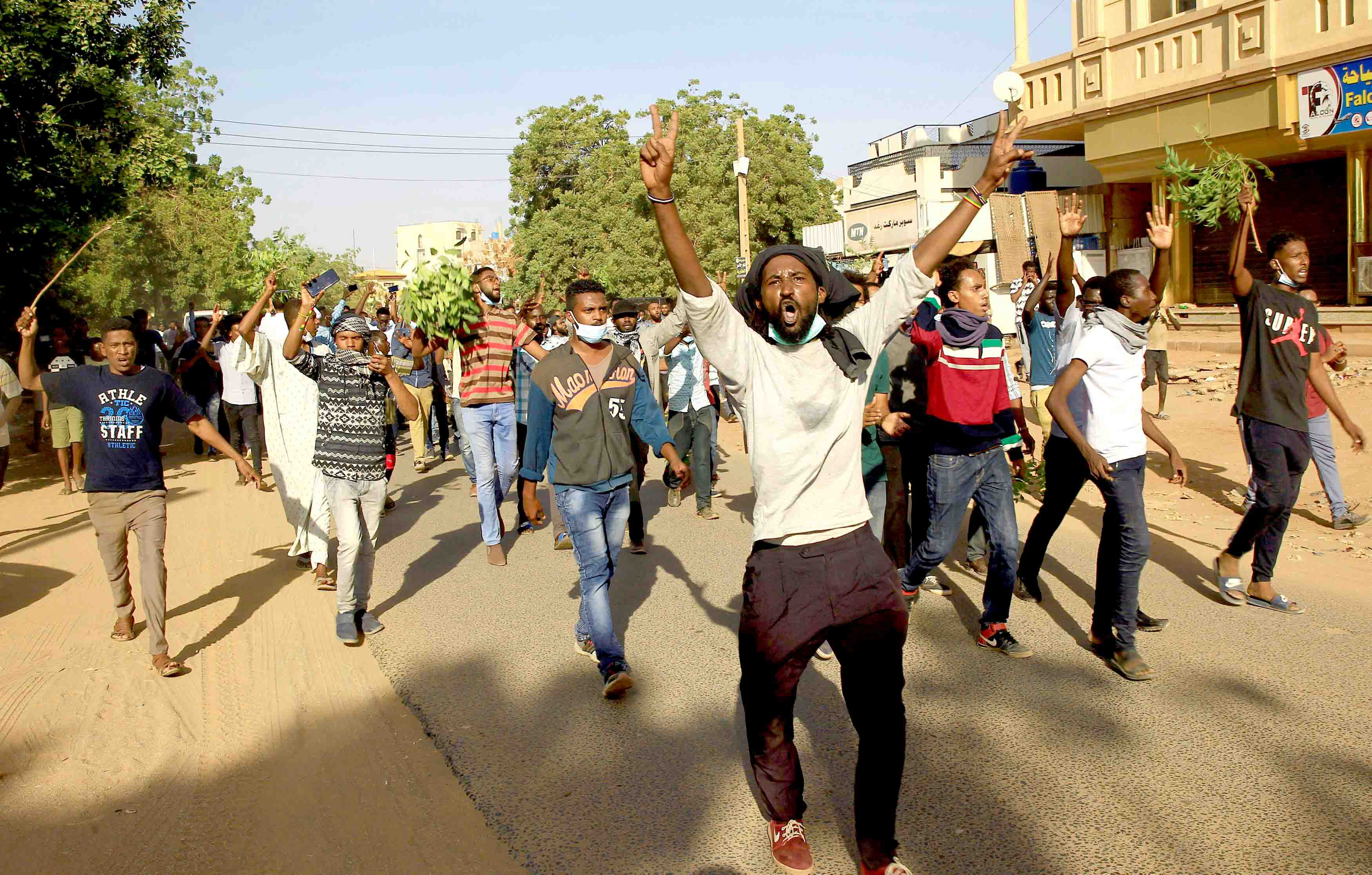 Sudanese protesters chant slogans as they march during anti-government demonstration in Khartoum, December 25. (Reuters)