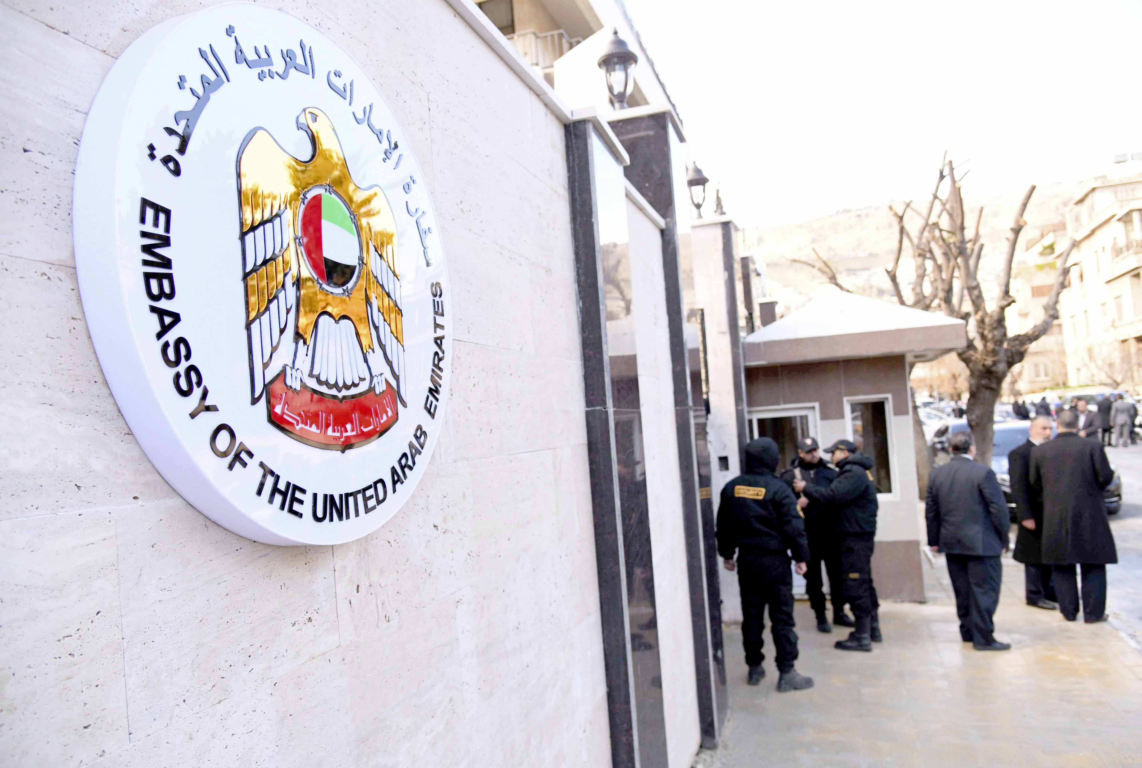 Officials and journalists gather outside the embassy of the United Arab Emirates in Damascus, December 27. (SANA)