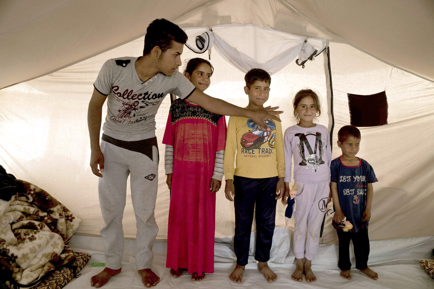 Children of an ISIS fighter pose for a family portrait at Daquq Camp near Kirkuk, last April. (AP)